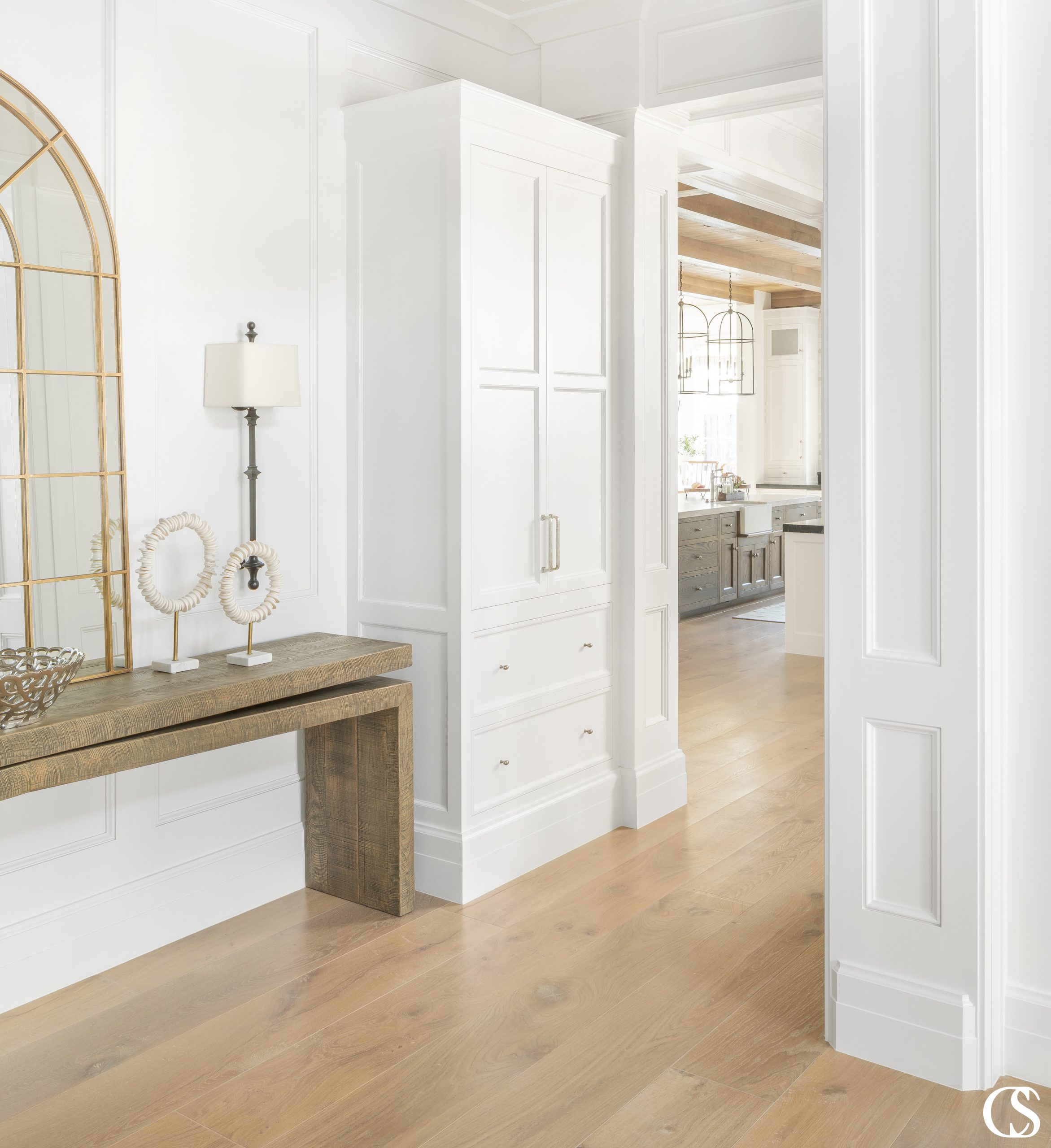 Why not use that extra corner space to add a coat closet to your entryway? With that perfect built-in look, it'll create functional beauty and purpose to your home.
