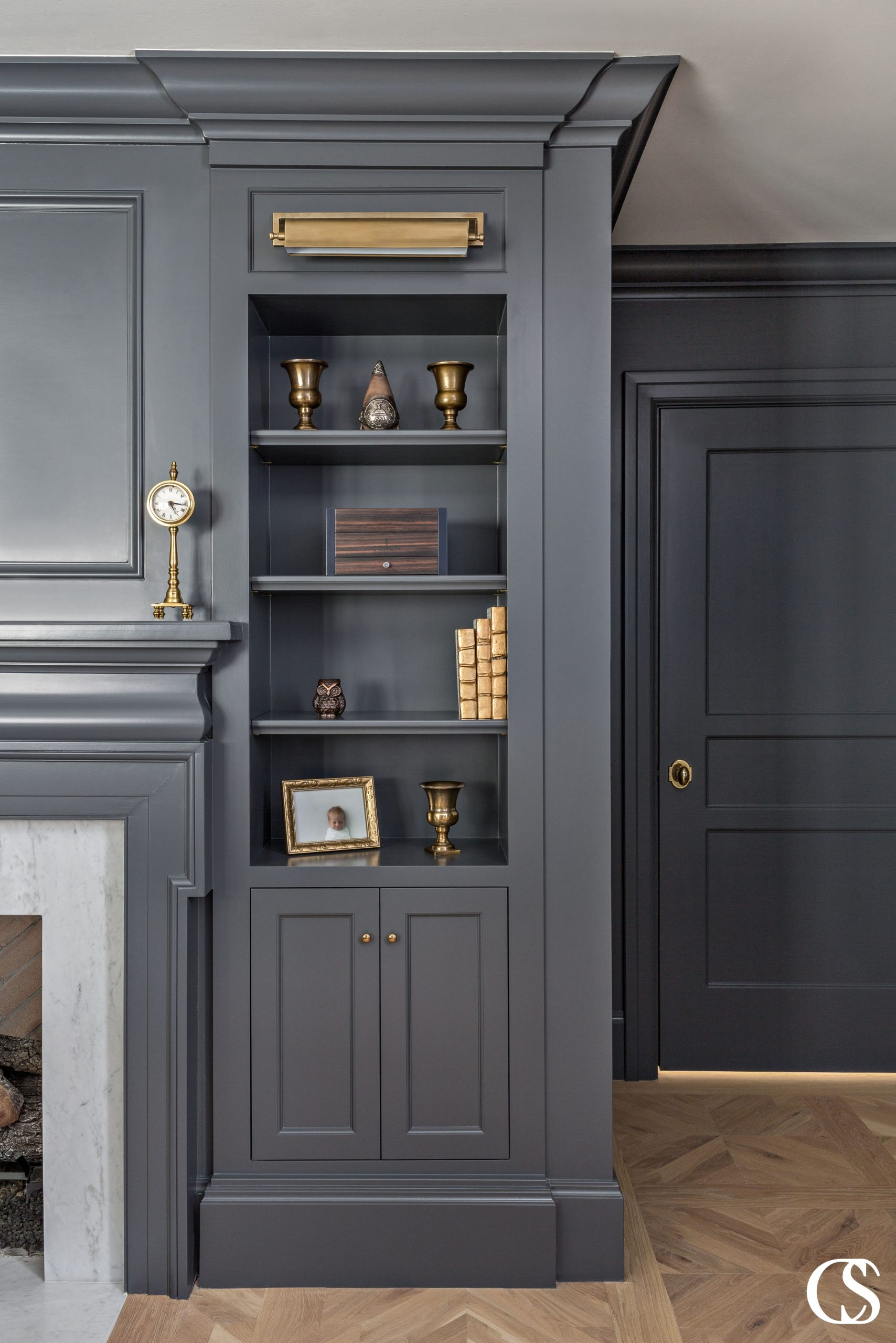 Why not add some built ins flanking the fireplace? The best custom cabinets provide for your family's needs, but also add to the character of your home. Bonus if they're in a moody shade of paint!