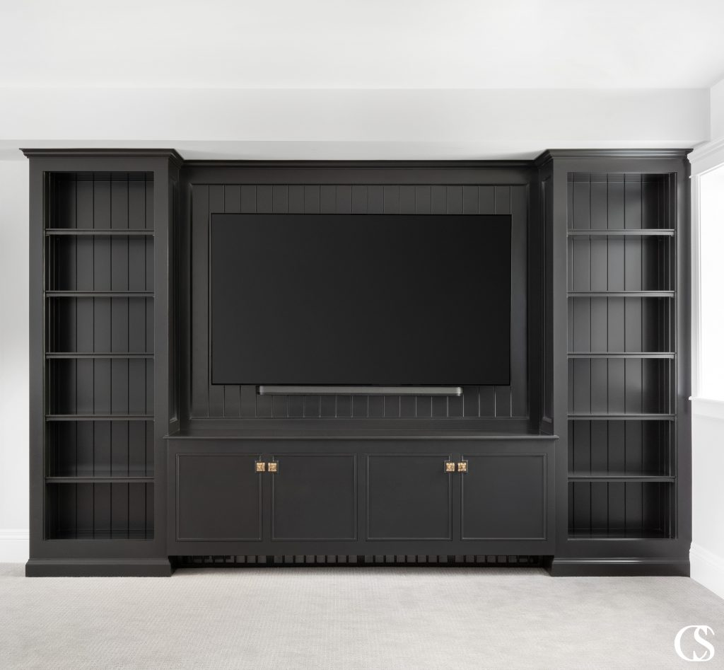 When you begin looking for entertainment center ideas it is important to consider how you and your family will be using the space and what items you'll need to store. Is this a gathering room that will need to accommodate a variety of activities such as high-tech gaming along with low-tech gaming (board games)? Do you have a large collection of DVDs or collectible vinyl albums to store? Would you like to incorporate lighting into the display areas? These are just a few of the questions for you to consider when creating the best custom entertainment center.