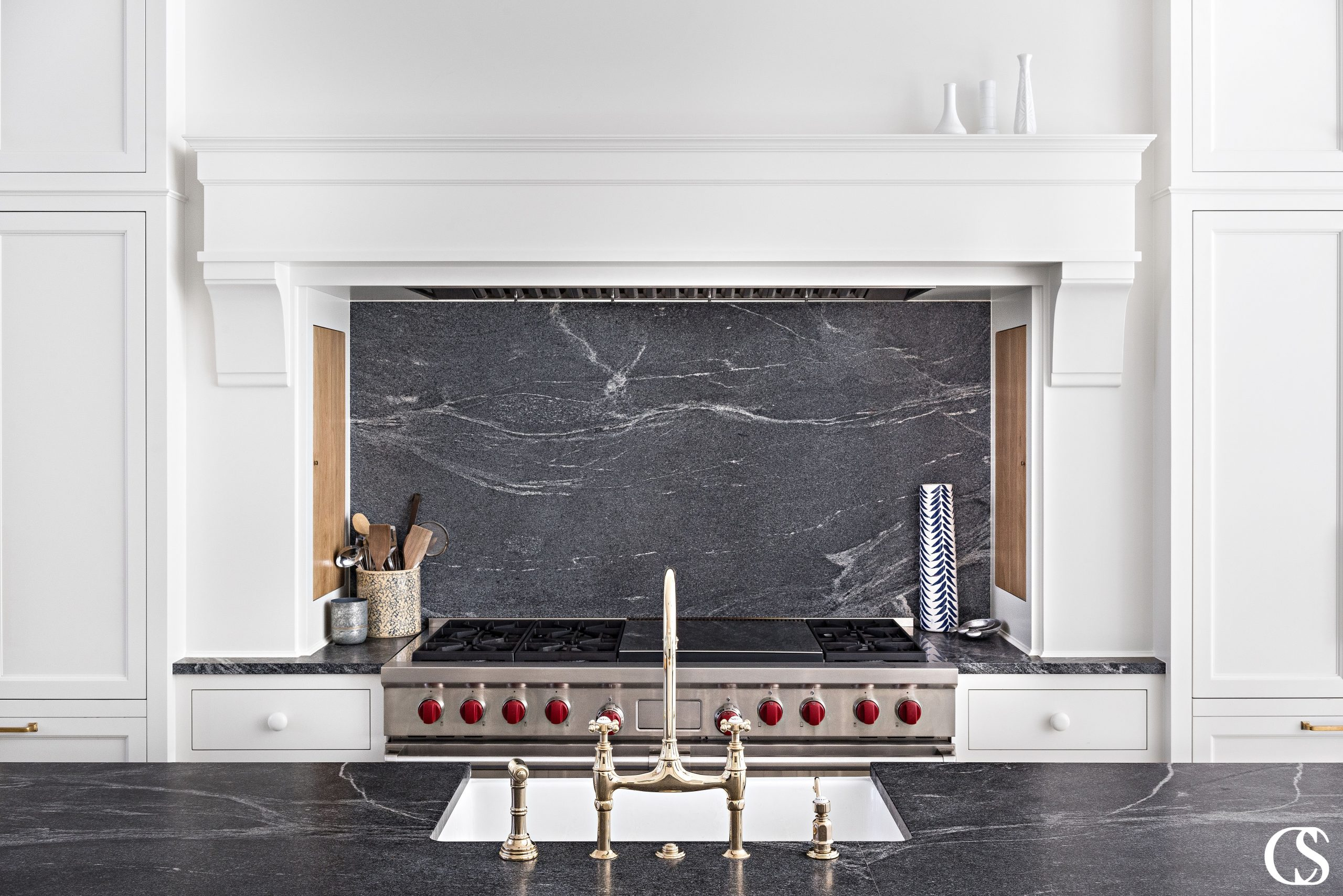 In my mind, the best custom kitchen cabinets provide for every need of your family—even if (especially if??) that need is secret compartment cupboards on either side of the stove.