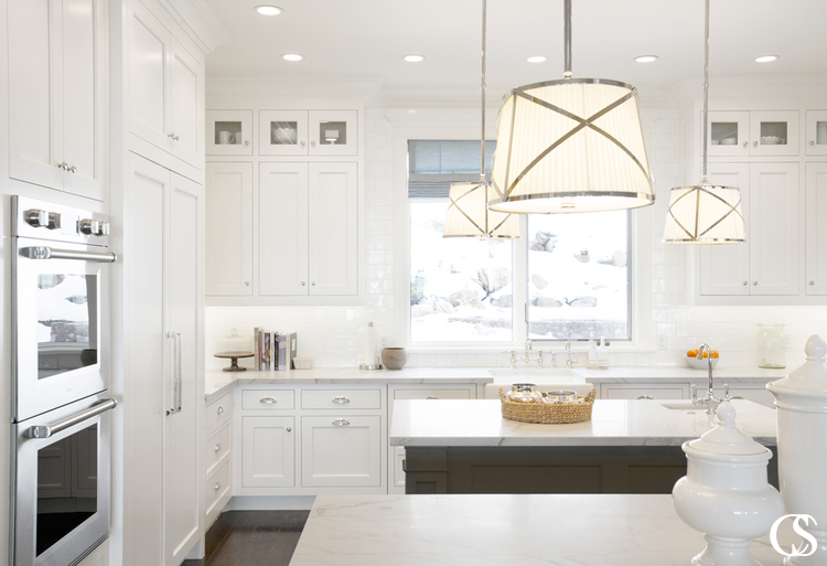 The best custom kitchen cabinets are the ones that provide the best functionality for your family, whether that's hiding the refrigerator or displaying family heirlooms.
