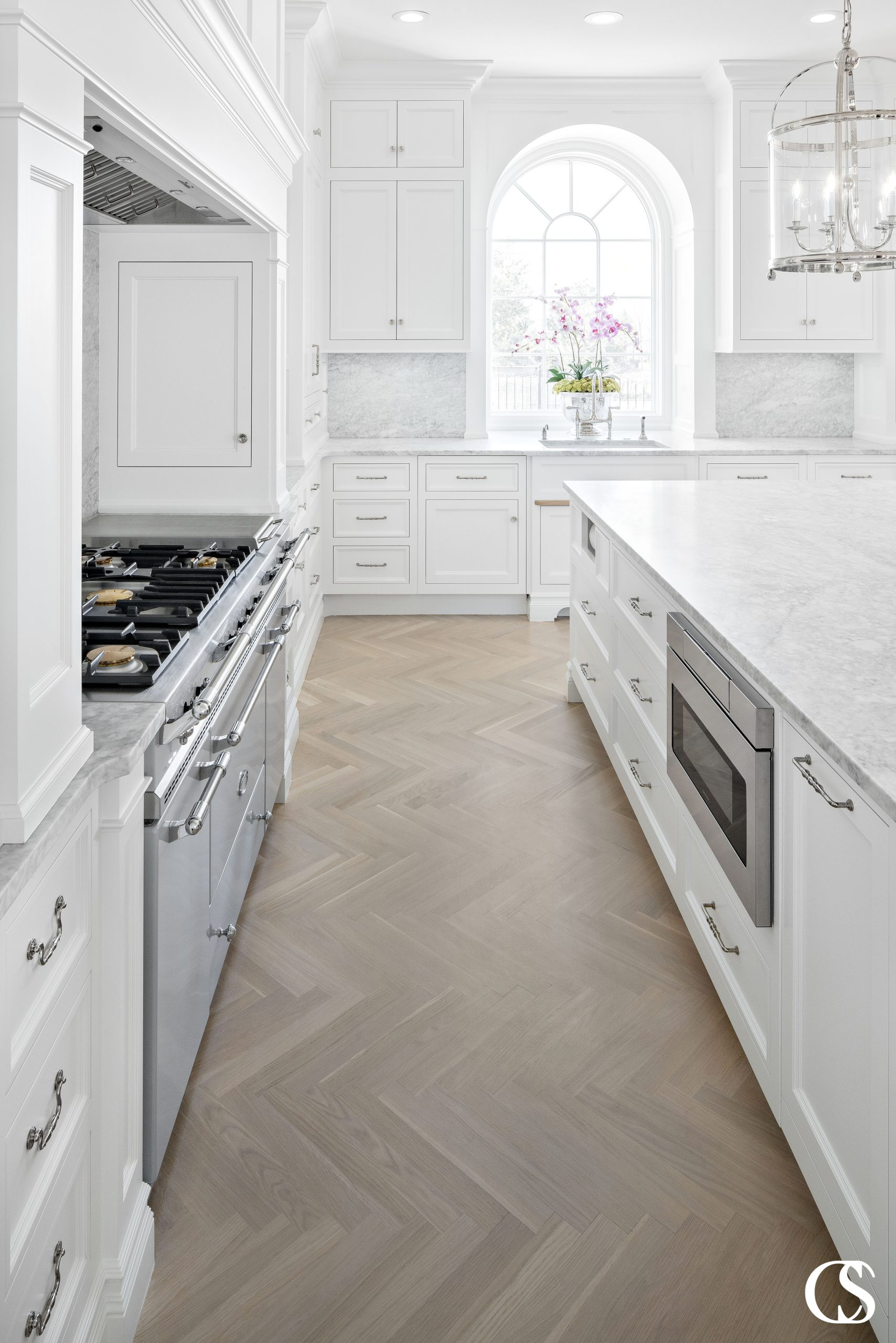 Some of the best white kitchen designs will utilize all the natural light they can to keep it feeling bright, open, and clean.