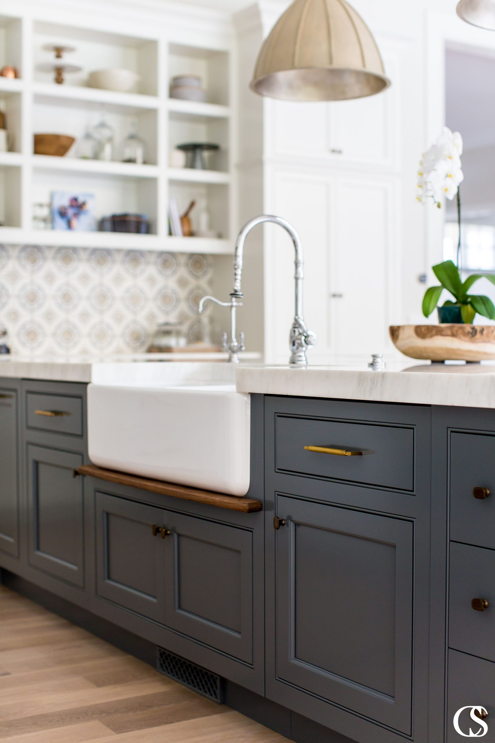Blue custom cabinets in the kitchen don't have to be bright or overwhelming. I love the subtle, almost smokey blue of this kitchen island and how it grounds a mostly white kitchen.