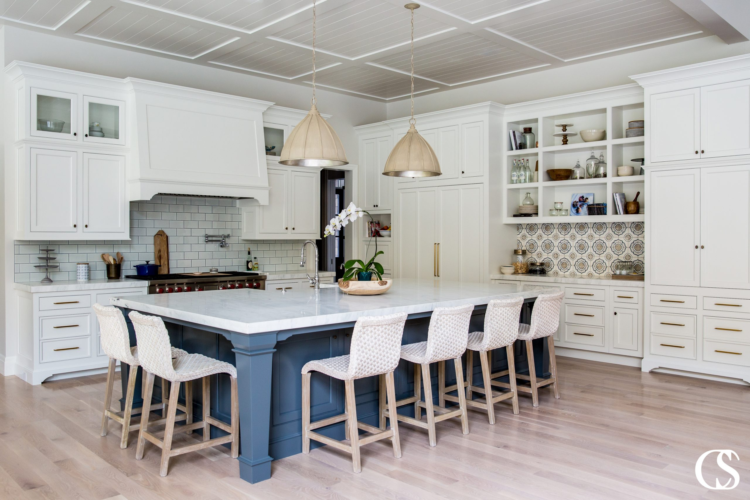 This custom blue kitchen cabinet design creates a room that maximizes space for your social and working needs.