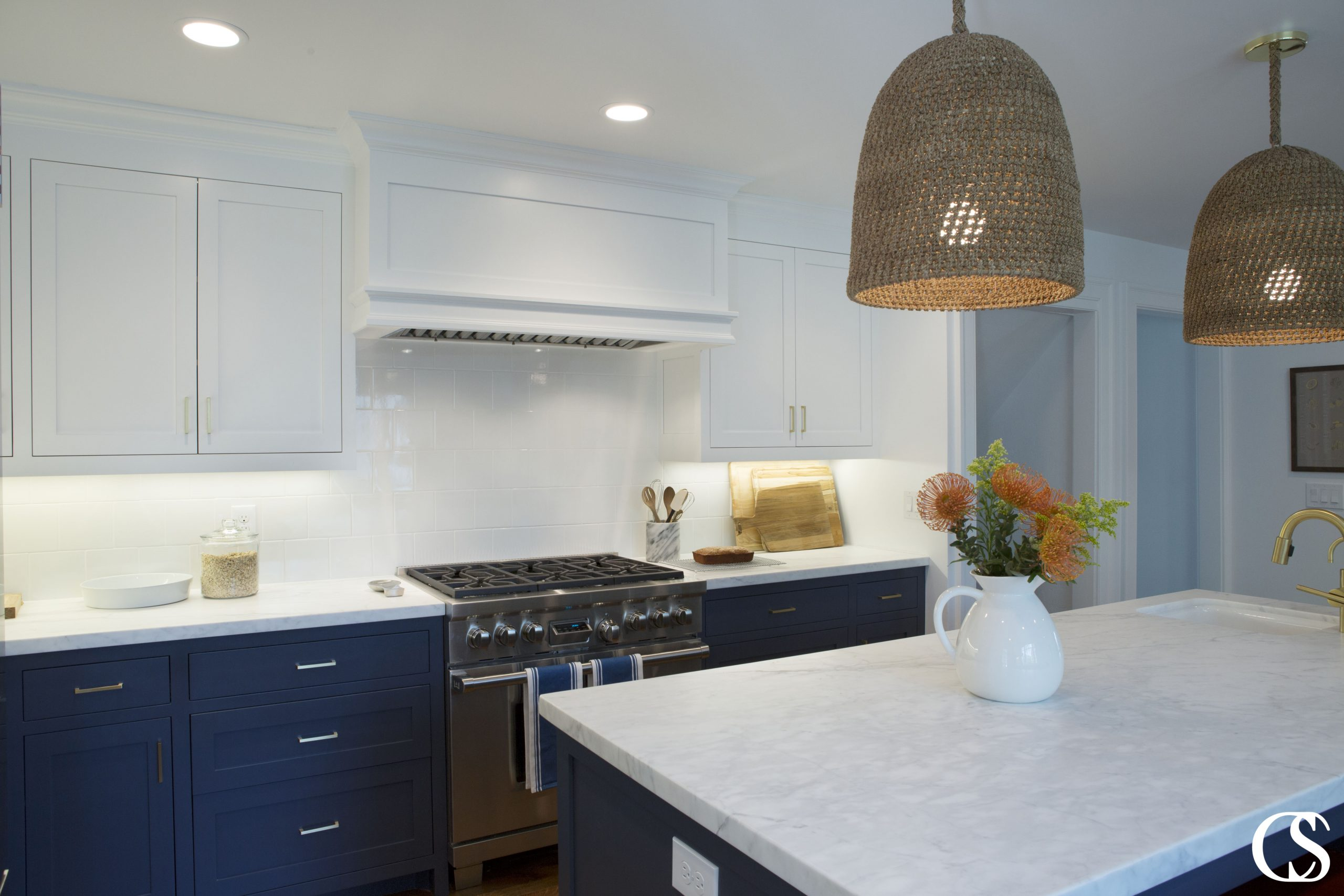 Why not pair blue and white to create truly unique custom cabinets? This color combo is a classic but still makes the space feel bright, balanced, and FRESH.