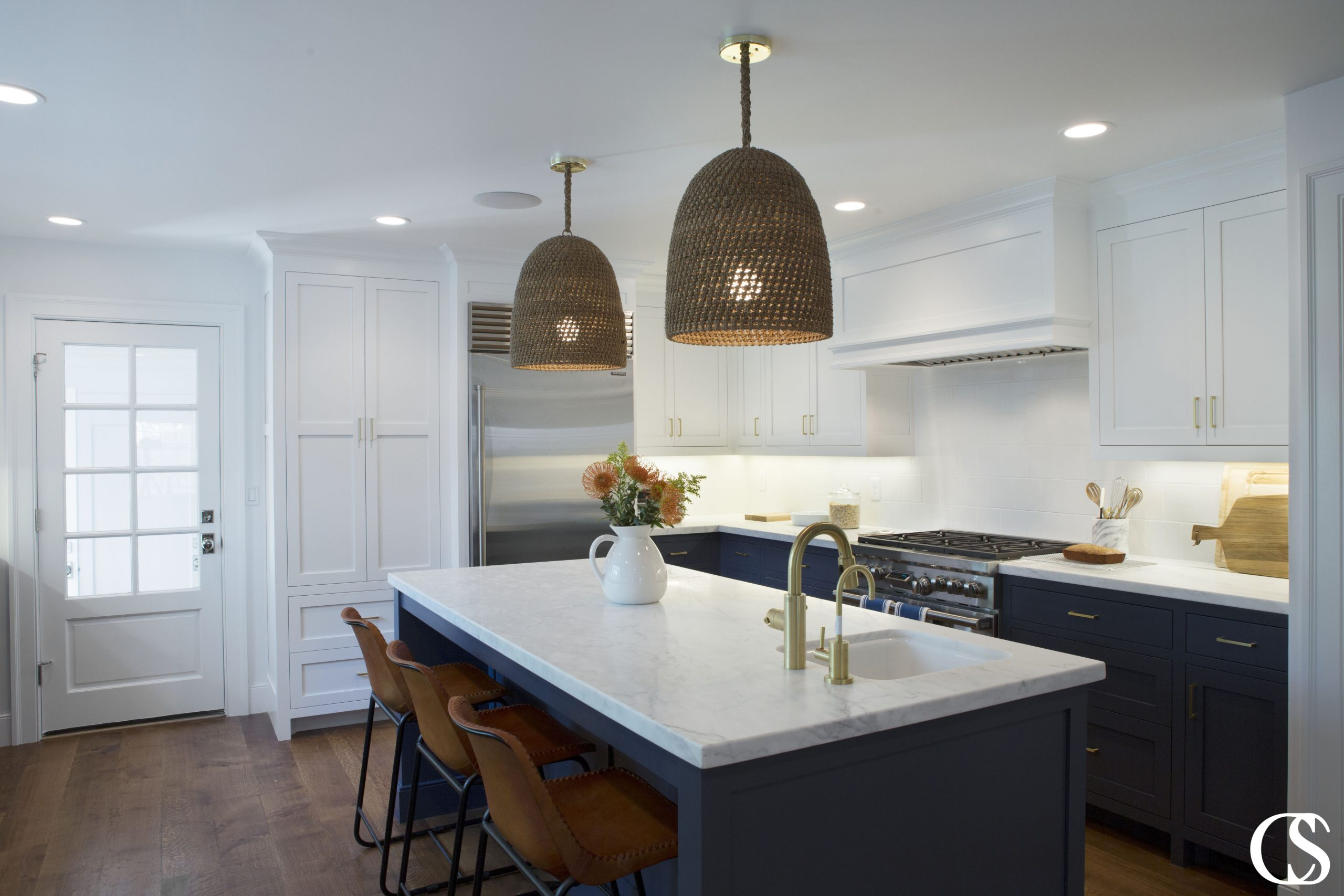 Creating a unique blue custom kitchen doesn't have to mean straying from a standard (and working!) kitchen layout. Make a statement with blue custom kitchen cabinets paired with white uppers to bring light into the space.