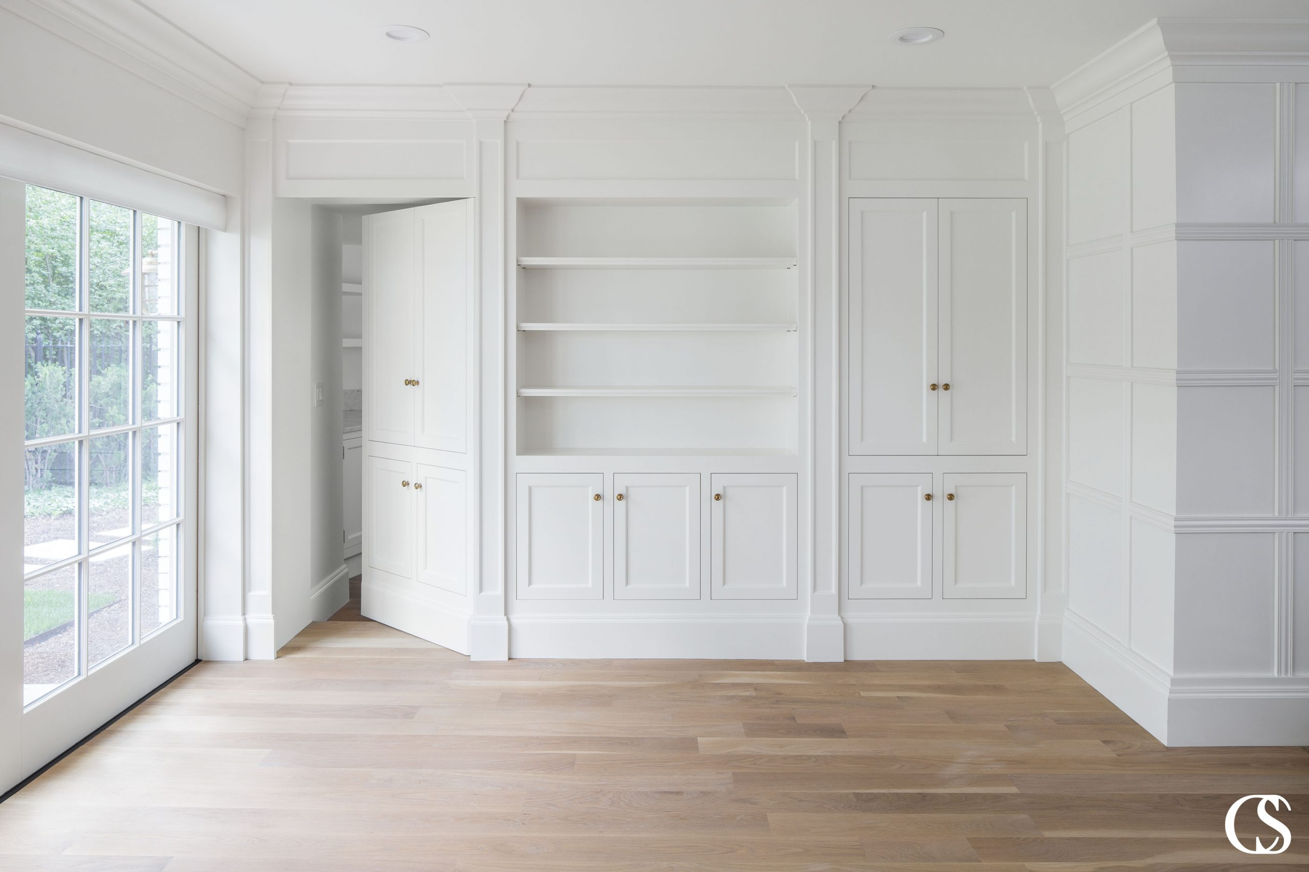 What if your custom built ins were more than just built ins? What if they housed a built in cabinet closet or secret entrance to the next room? Yeah, we've got your back.