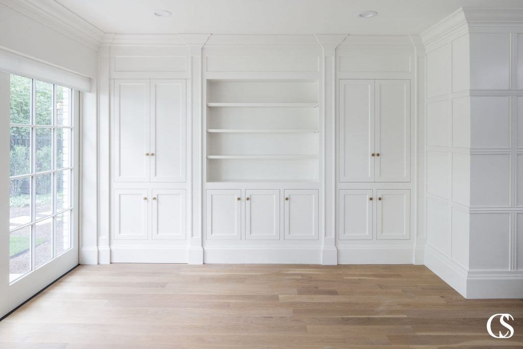 """Fully custom means getting a 100% unique design based on the space, intended aesthetics, and personal functionality needs. Every element is literally made to order (or """"bespoke"""" if you're in the U.K.) to fit your space, down to a tiny fraction of an inch. A custom cabinet designer will find a way to respect an intended aesthetic while catering to your specific needs of storage. Fully custom means that you get exactly what you want."""