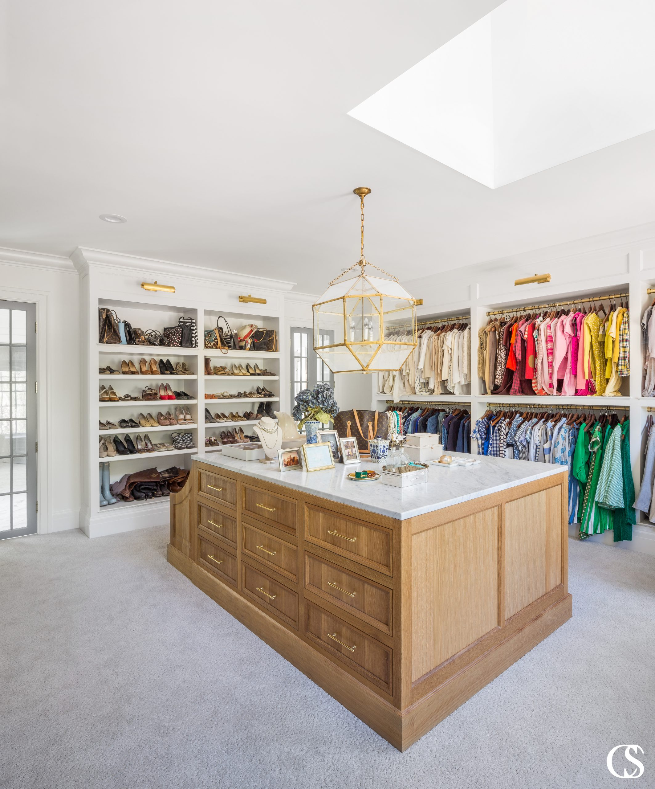 Don't forget the island full of drawers when coming up with built in closet ideas. You'll need space for delicates, jewelry, and even a comfy seat to put on shoes or just relax after a long day.