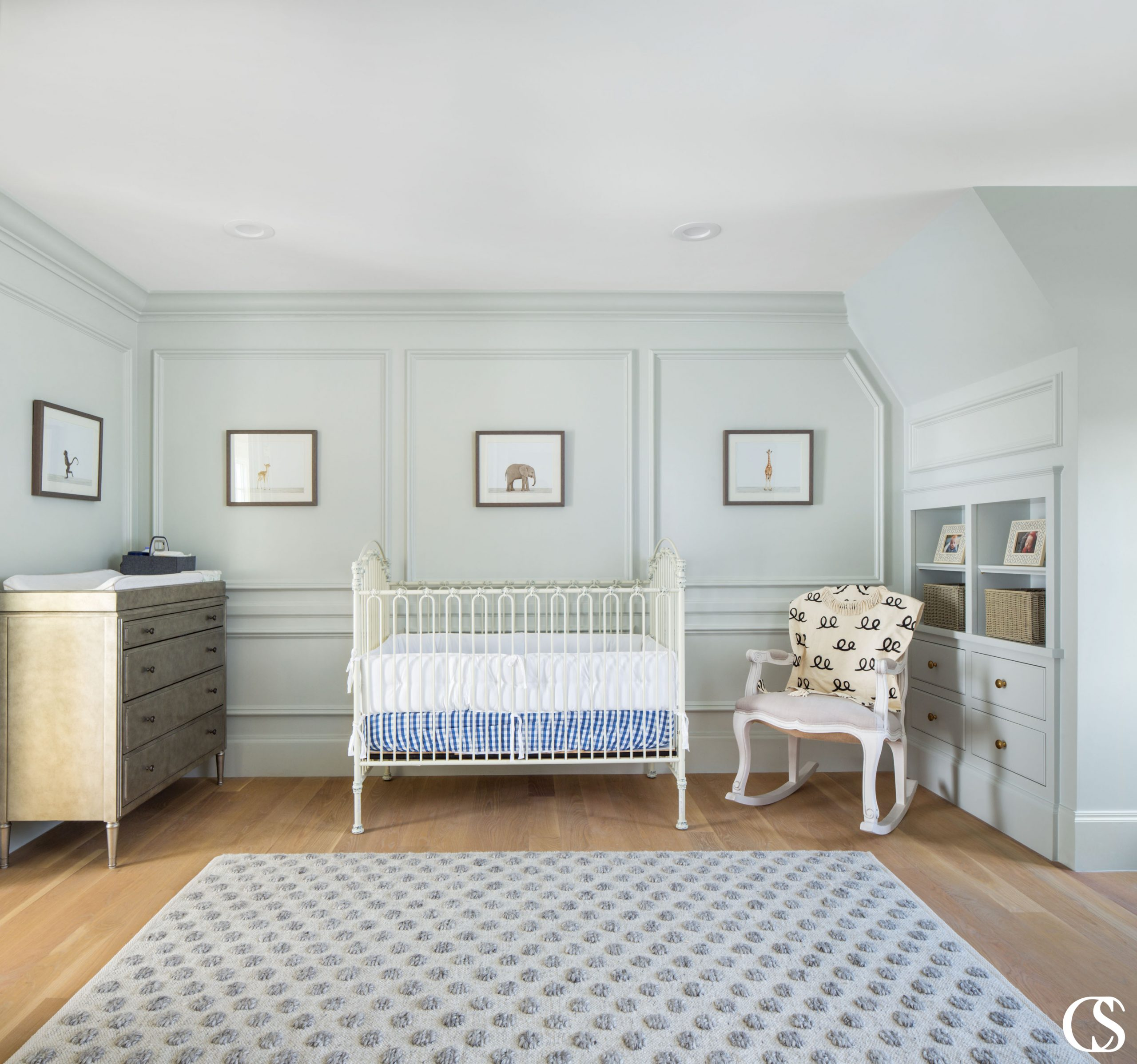 Every corner of this sweet nursery is enhanced by built in design. From decorative molding to built in cabinets and shelves, it all adds character and interest to the space.