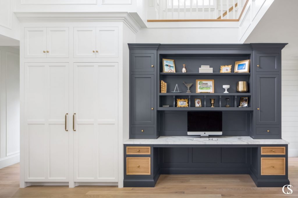 If your floor plan doesn't allow for a completely separate office, many other spaces in the home lend themselves to becoming a built-in desk nook. This way, the unique built in desk takes advantage of a smaller existing space, often near the kitchen or just off the main living room.