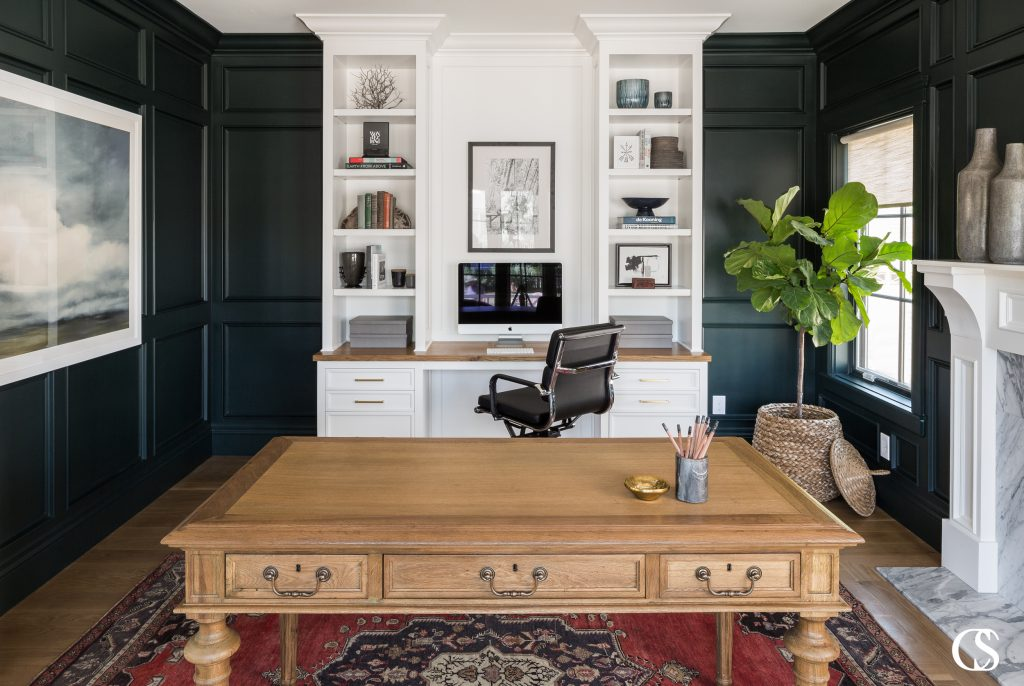 When designing your dream home office, make sure to include both open shelves for display items and drawers to hide away less attractive office supplies! For more of our best built in desk tips, check out the blog on ChristopherScottCabinetry.com!