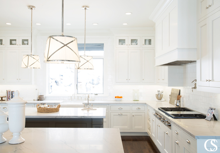 The cabinet designs for this kitchen include upper and lower cabinets, two separate islands, and a custom range hood. All designed with the owners exact specifications in mind.