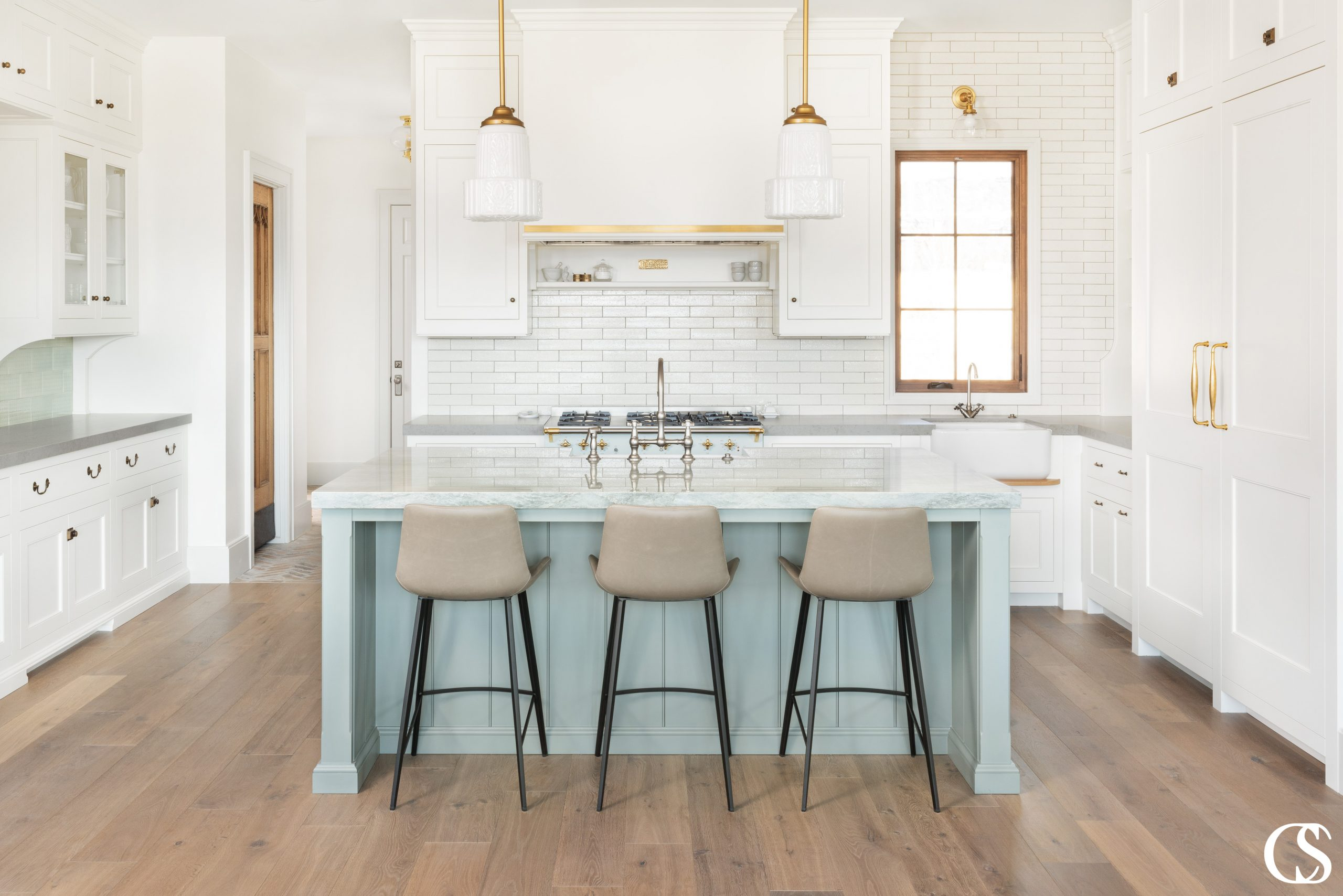 Why not add a splash of color to your custom kitchen cabinets? This pale blue makes this custom kitchen even more unique!