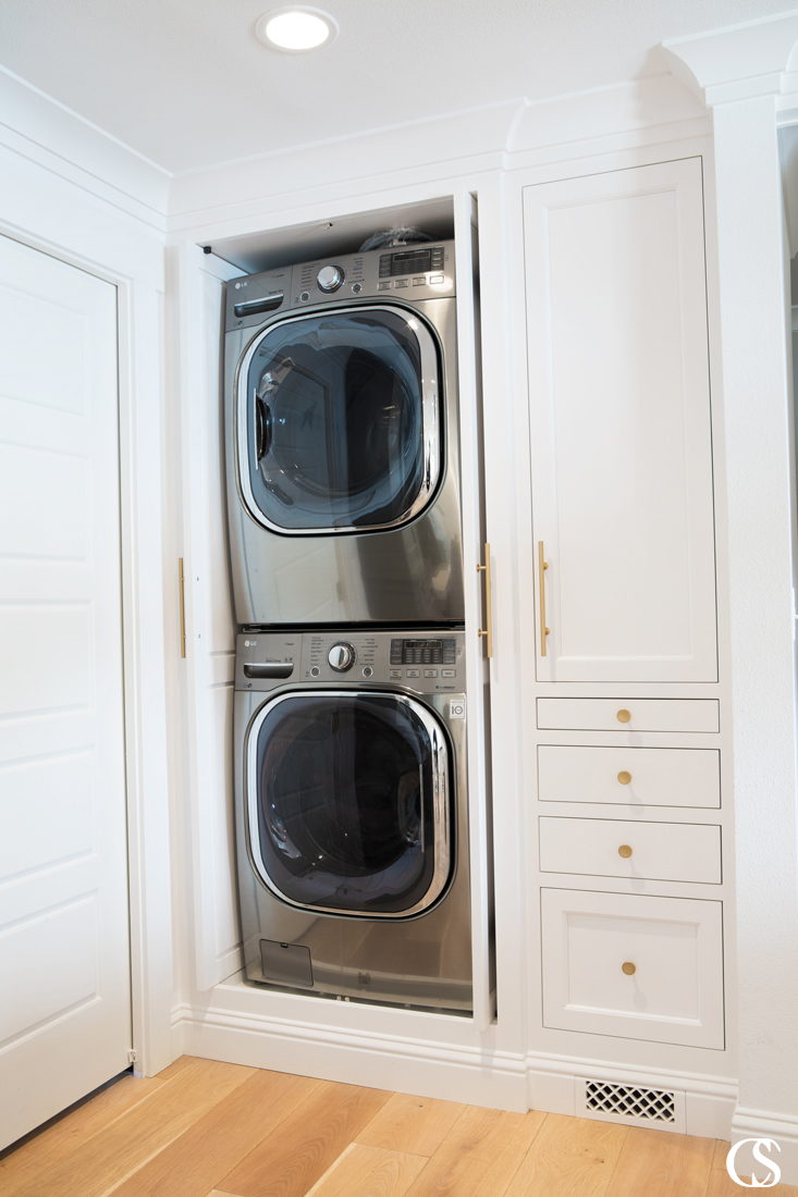 Who wouldn't want hideaway cabinets for their laundry? Especially if your washer and dryer don't have their own room!