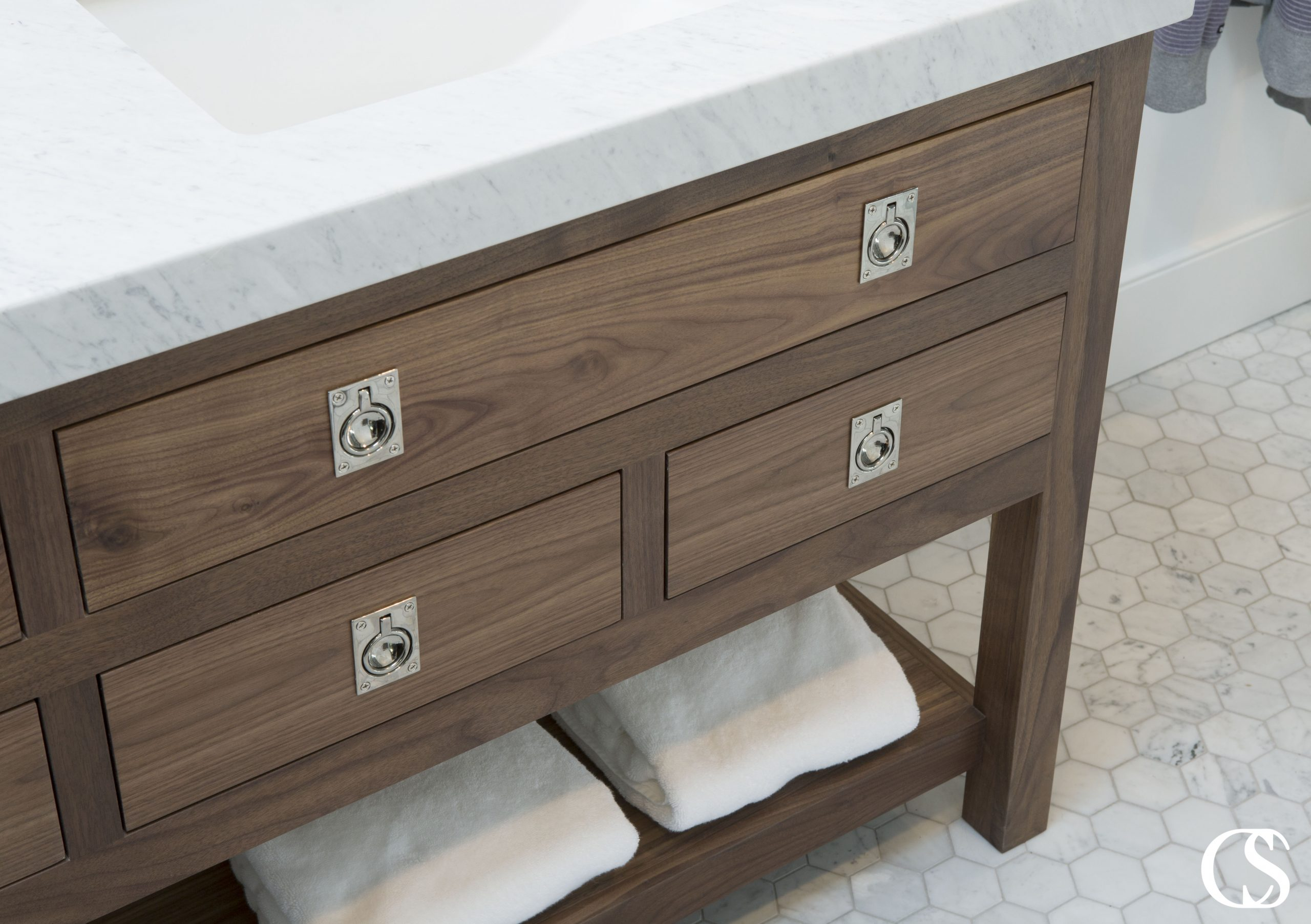 Slab style drawer fronts anyone? This unique custom bathroom cabinet pulls off a look completely different than most bathroom vanities—that's what working with professional cabinet designers will get you.