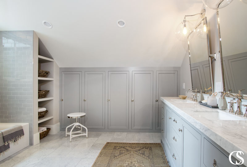 The locker-like custom bathroom cabinets in this space offer plenty of towel and paper product storage, as well as individual cubbies for the bathroom's users.