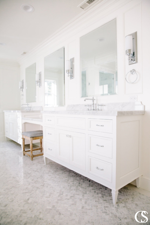 This custom bathroom design with two sinks separated by a vanity is an awesome way to make one room work as hard as possible for your family and guests.