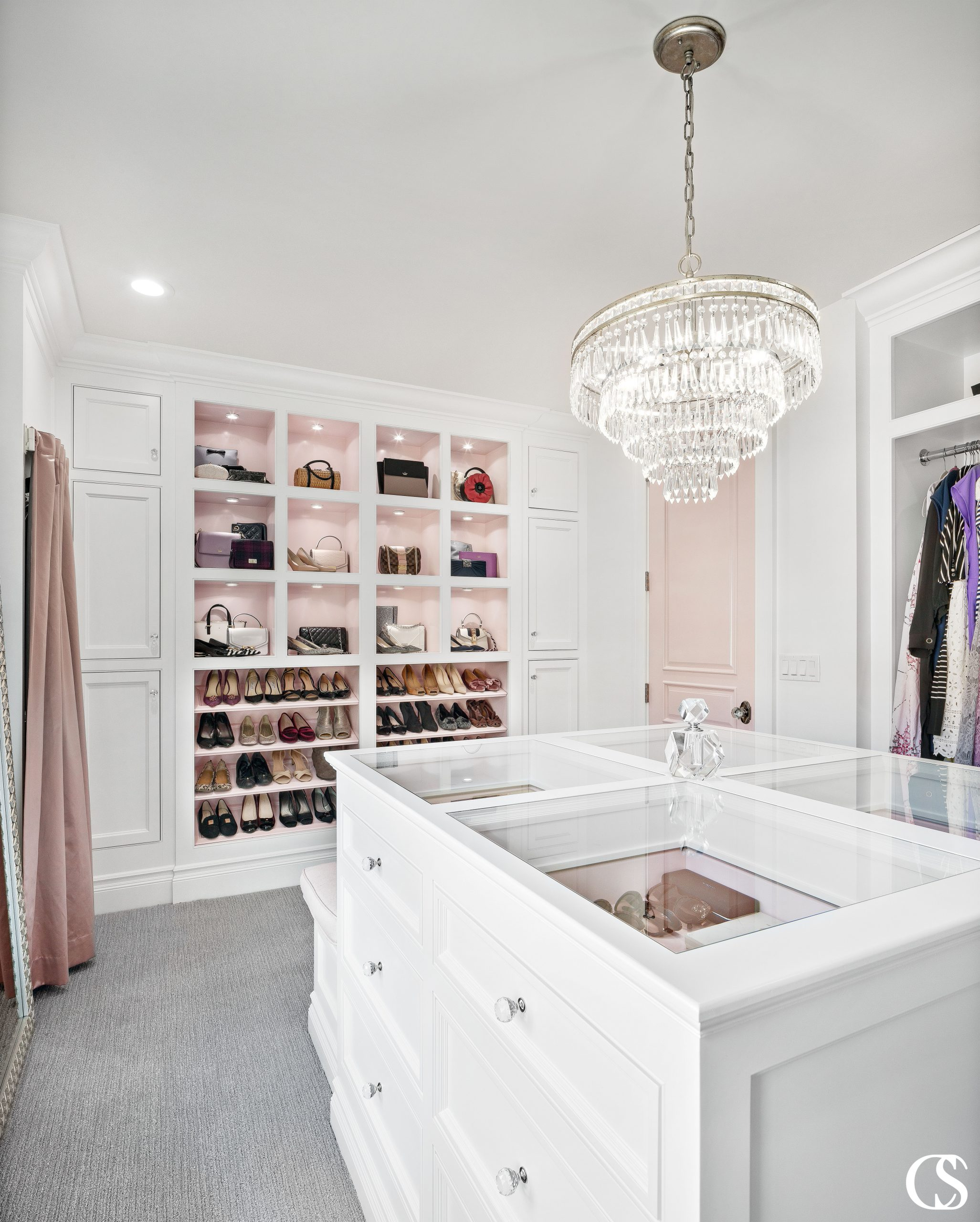 Custom built in cabinets in your closet give you the chance to display all your shoes, purses, and other accessories in a perfectly organized and beautiful way.