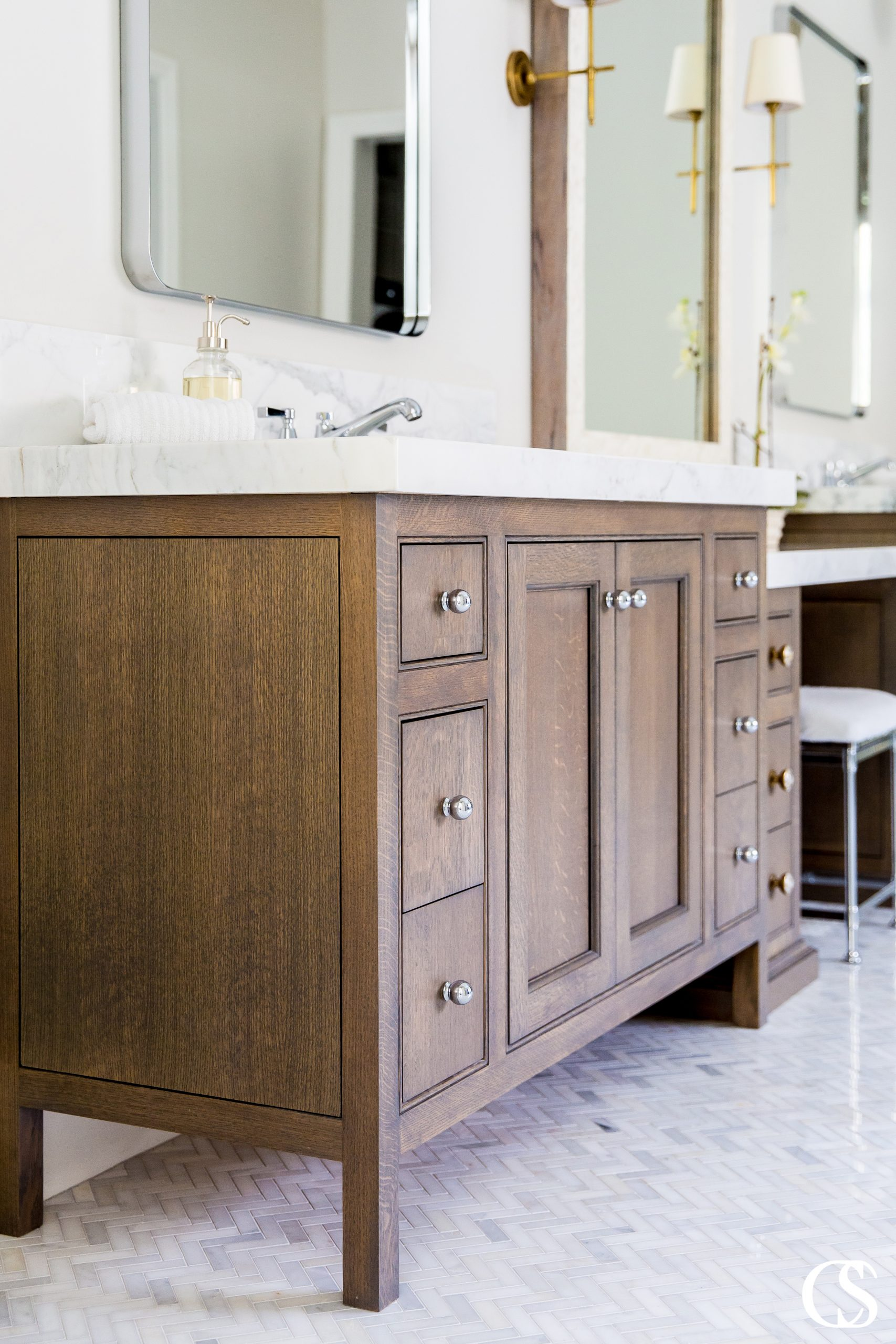 See the way the end piece of this custom cabinet design for the bathroom mimics the lines on the front? It's the details that make custom cabinet designs for the bathroom so unique and special.