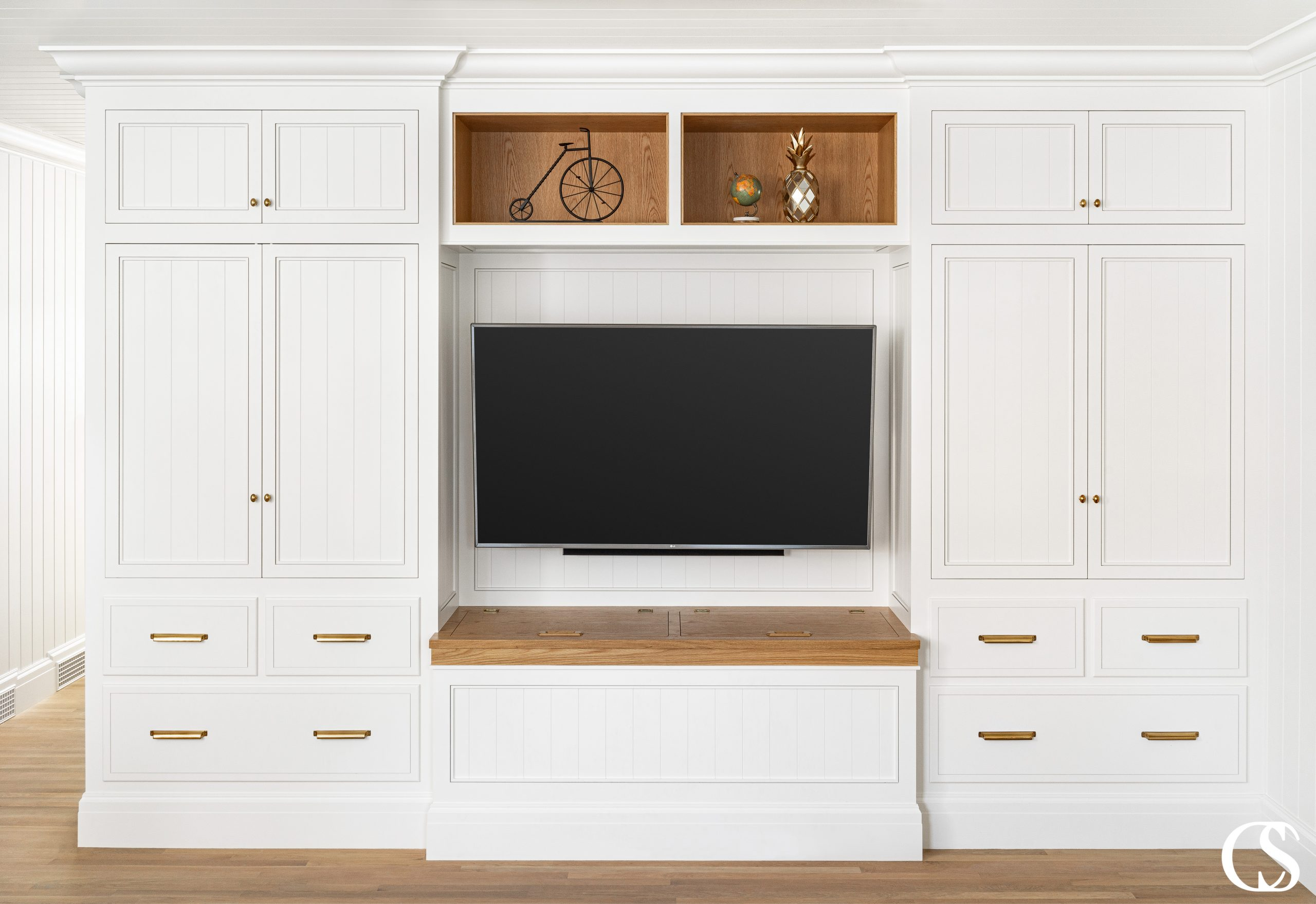 Those contrasting display shelves make this one of our most unique entertainment center ideas—you'd never find a custom cabinet design like this at the store.