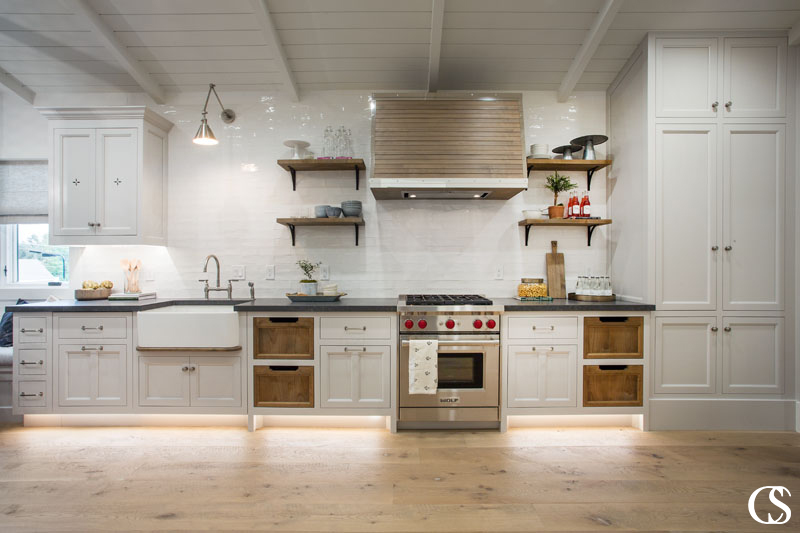 Without a lot of natural light, it was important to incorporate toe kick lighting to these custom cabinet for the kitchen to brighten it up from top to bottom.
