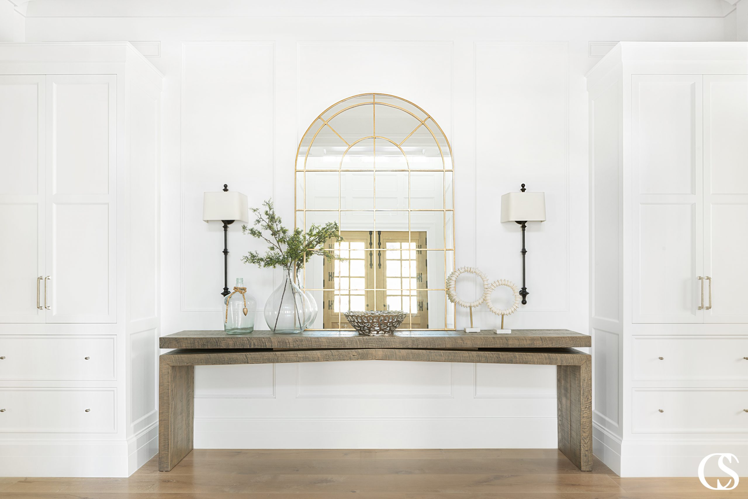 Technically, there's an infinite amount of styles and I am constantly surprised by the number of ways custom designers can find to make every cabinet and home feel perfectly unique—like with these custom cabinets for the home entry.