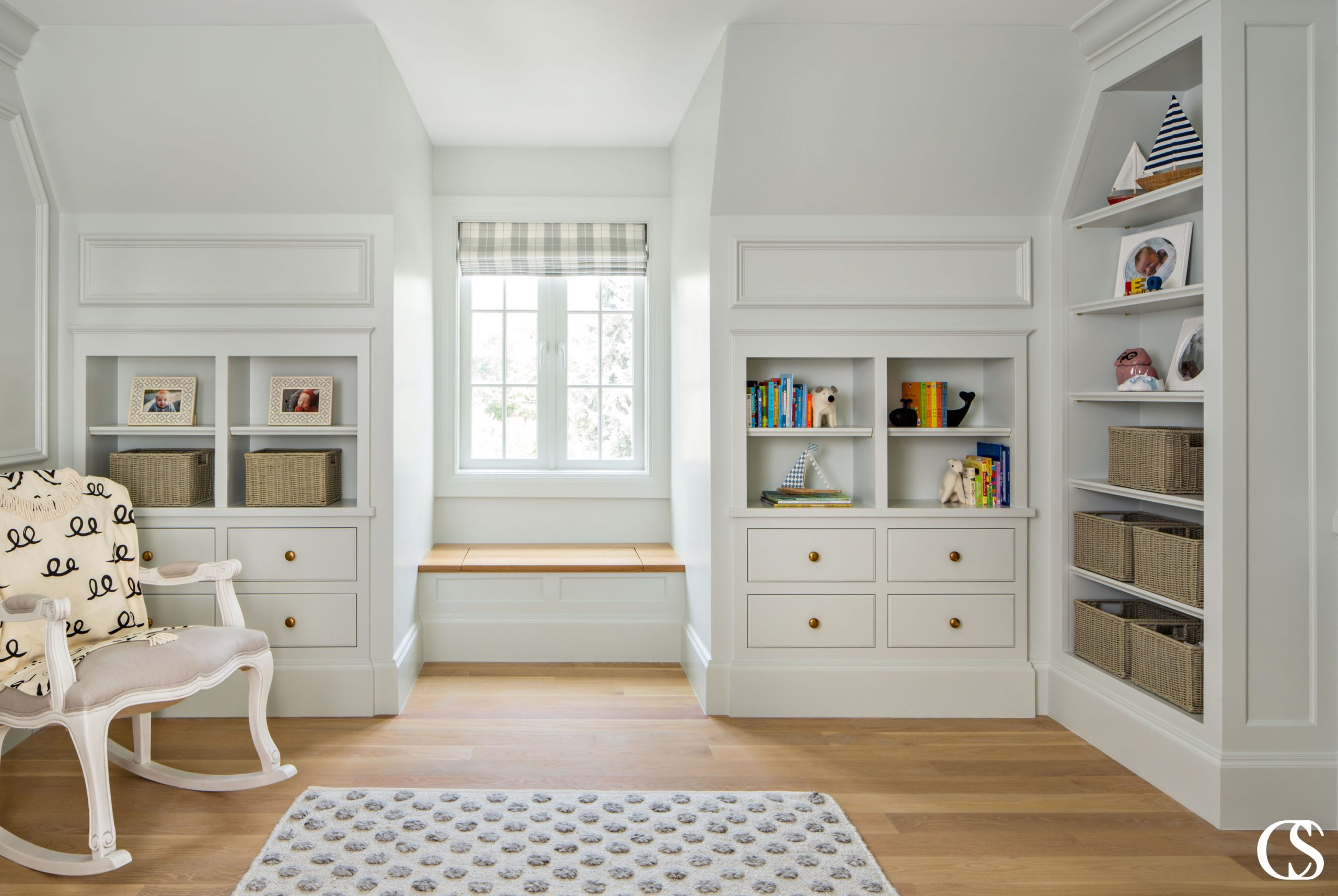 Commissioning custom cabinets for your home means fitting exactly what you need, where you want it. Like these custom nursery cabinets with their perfect tiny window seat for snuggling up and reading together.