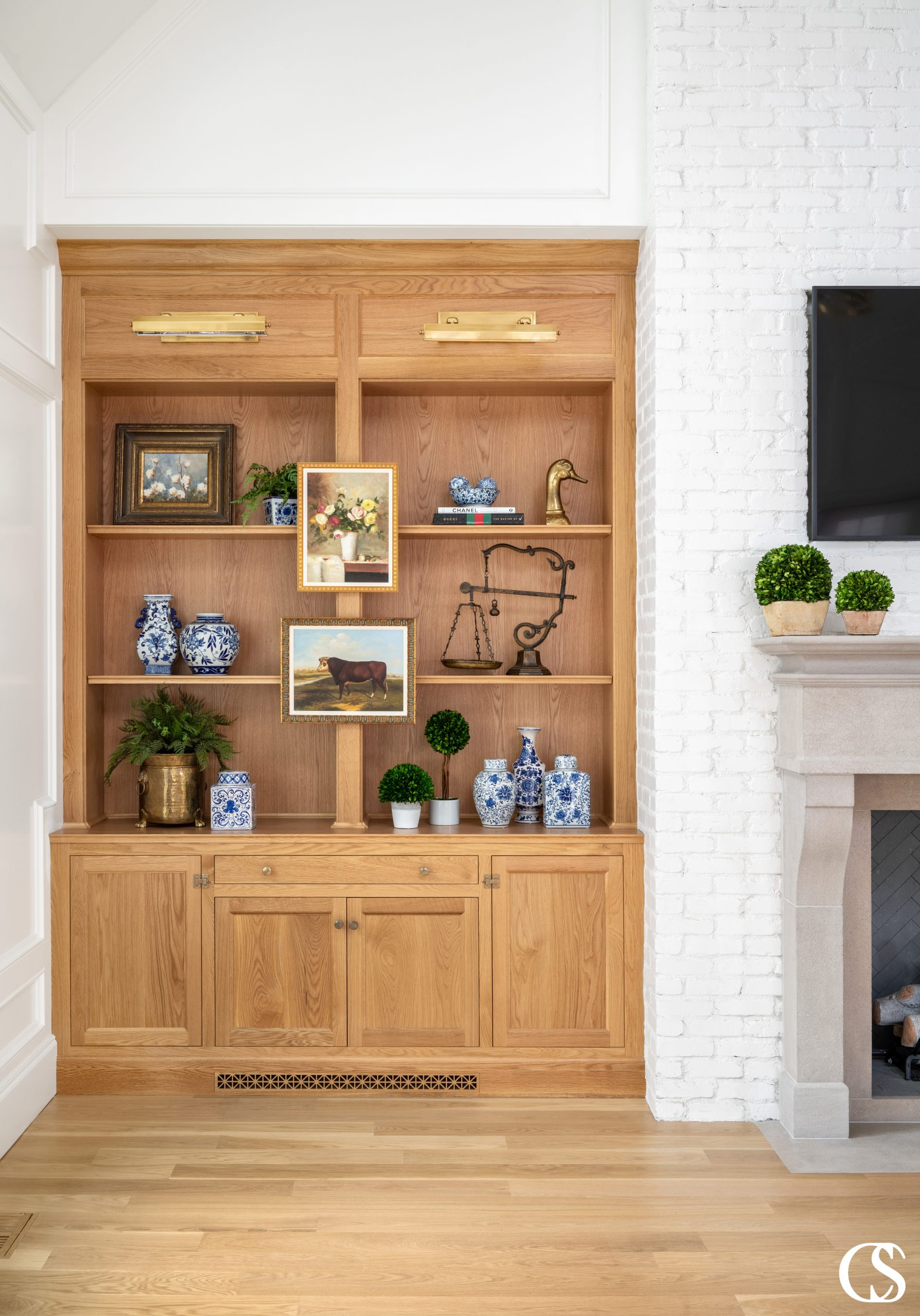 Designing custom cabinets for the home often means making them feel like they belong, like they've always been part of the house plans—even if that means using different colors and materials than what surround them.