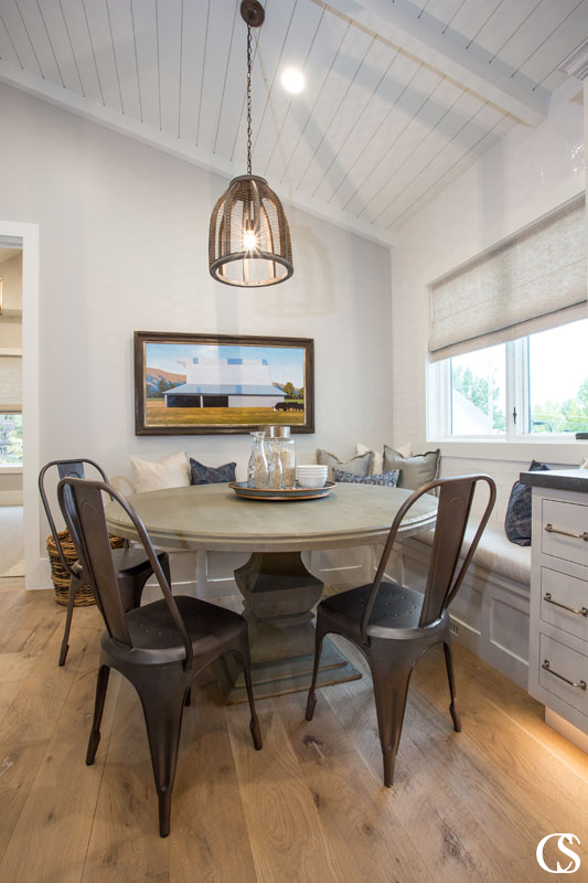 Why not add a cozy window seat to the custom cabinets for your kitchen? It adds such a homey feeling to the breakfast nook and adds some sneaky storage as well.