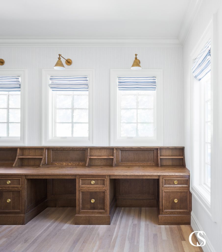 If you have more than one child, creating custom cabinets for a home office might mean multiple desks. This custom built in desk creates those necessary separate spaces, but with one continuous worktop for unimpeded design flow.