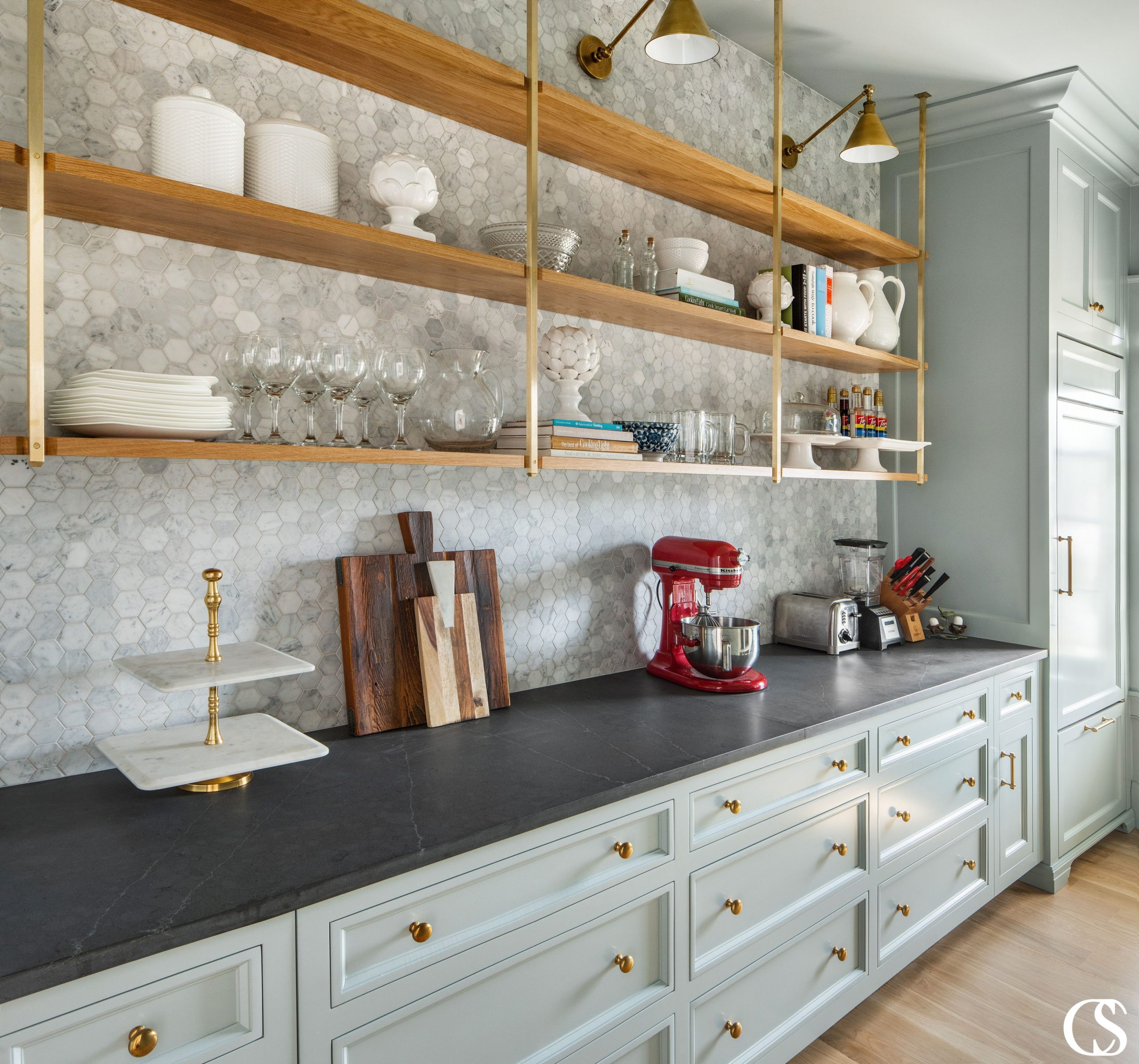 It doesn't hurt to go through your current kitchen items and make a list of the large item sizes and any personal kitchen items that are unique to your lifestyle (tea storage, coffee makers, large knife sets, sport bottles, china, tupperware, etc.) so that your custom cabinets in the kitchen can hold it all.