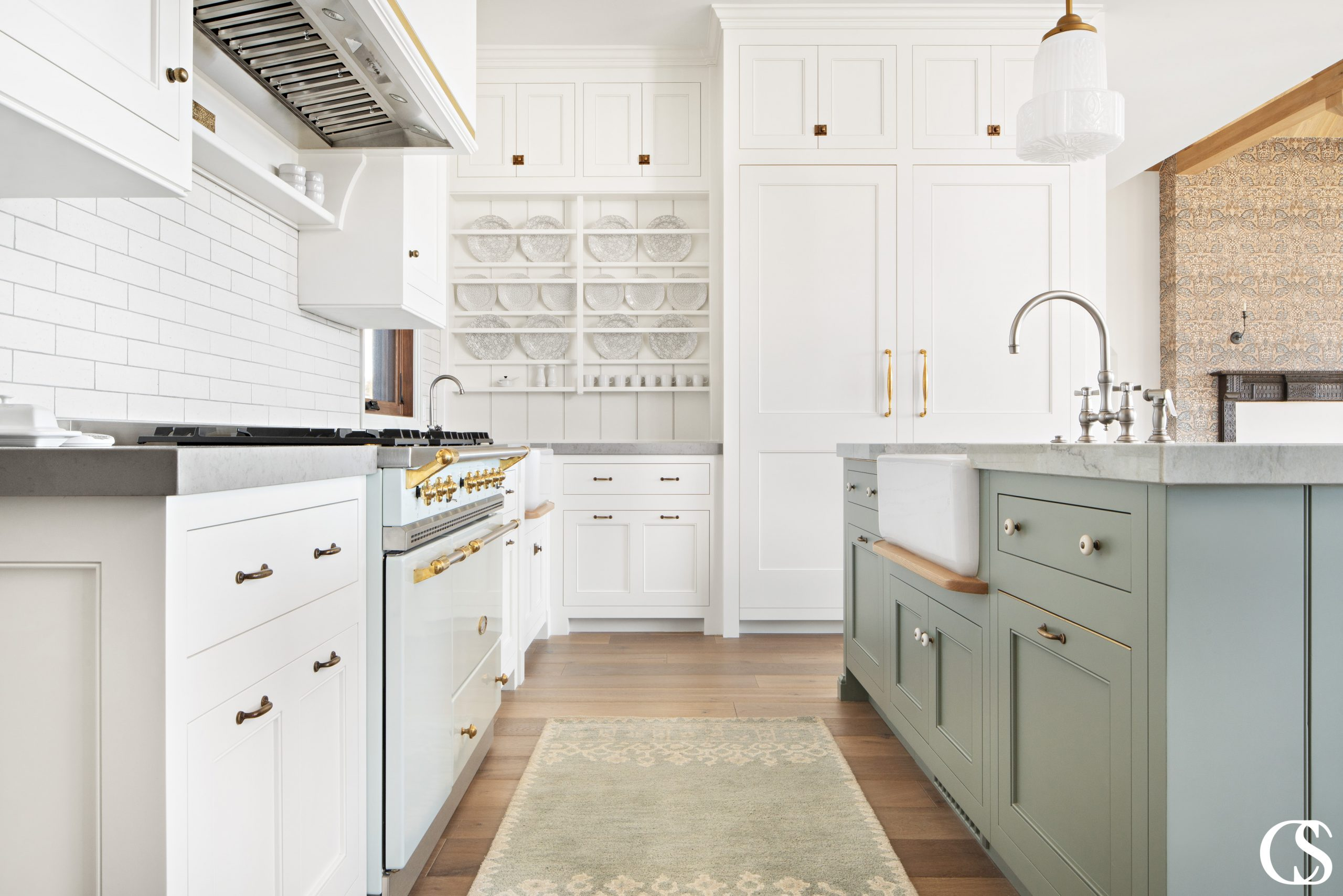 What better way to solidify your farmhouse aesthetic than with custom kitchen cabinets complete with a beautiful farmhouse sink?