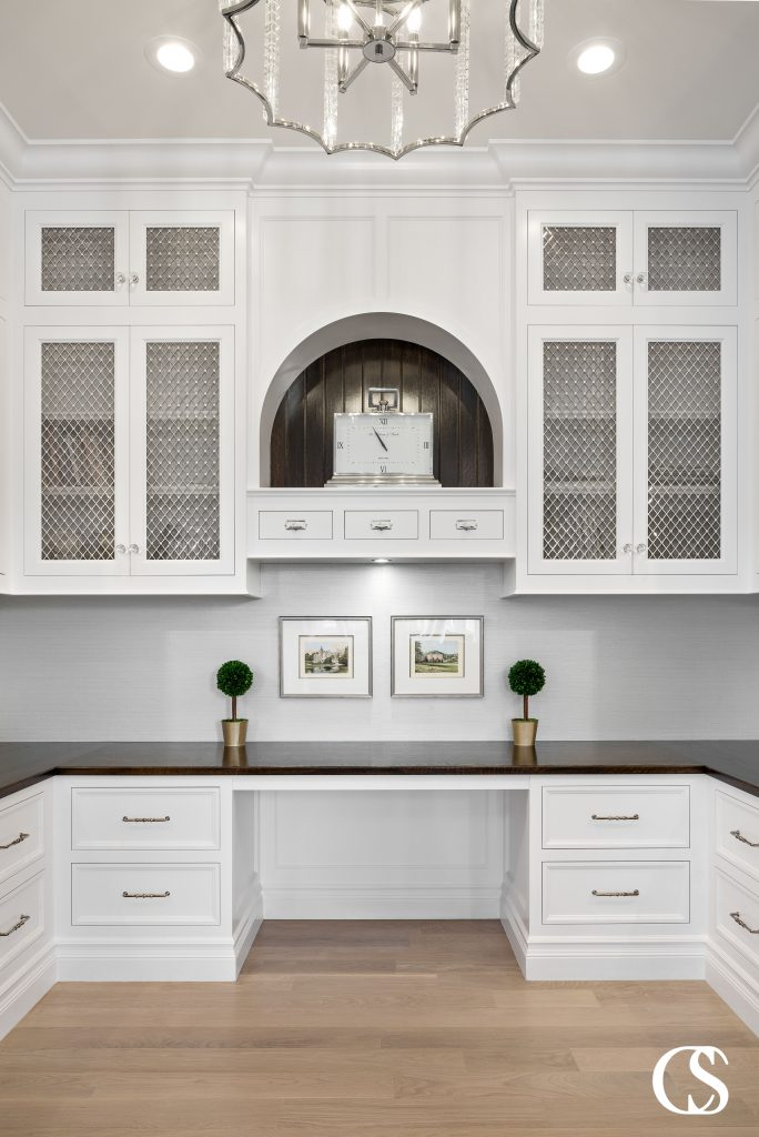 The mullions on the glass doors of these custom office cabinets add so much eye candy to this work from home space.