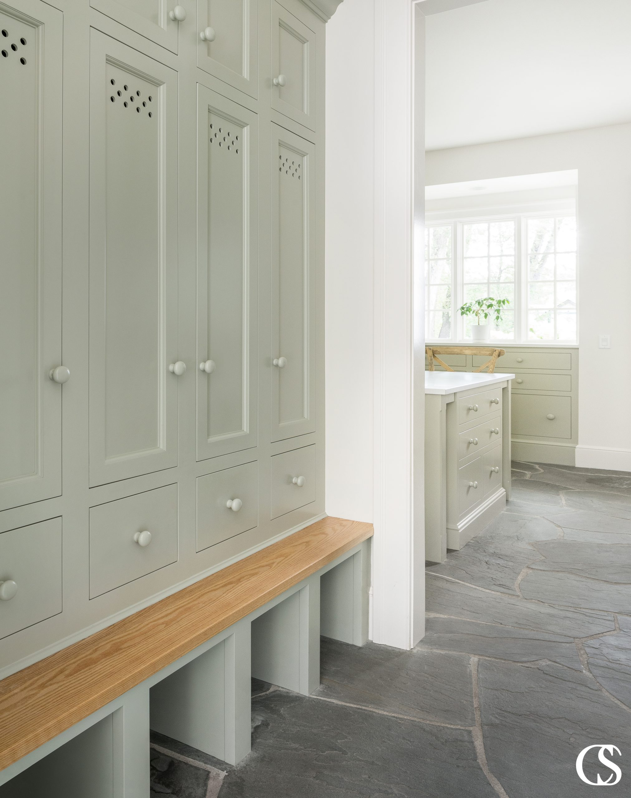 Having a custom entry way cabinet with a bench works for so many reasons—not least of why because it makes a great place to perch when removing shoes.