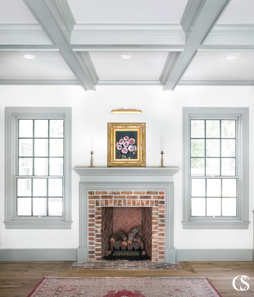 By reflecting the painted ceiling beams, this custom fireplace design looks 100% original to the home design. Which is exactly how custom cabinetry should look and feel.