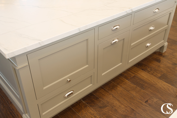 """Custom kitchen cabinet design means creating spaces you would find in """"off the rack"""" cabinetry. Like a sneaky space for keeping the microwave off the counter."""
