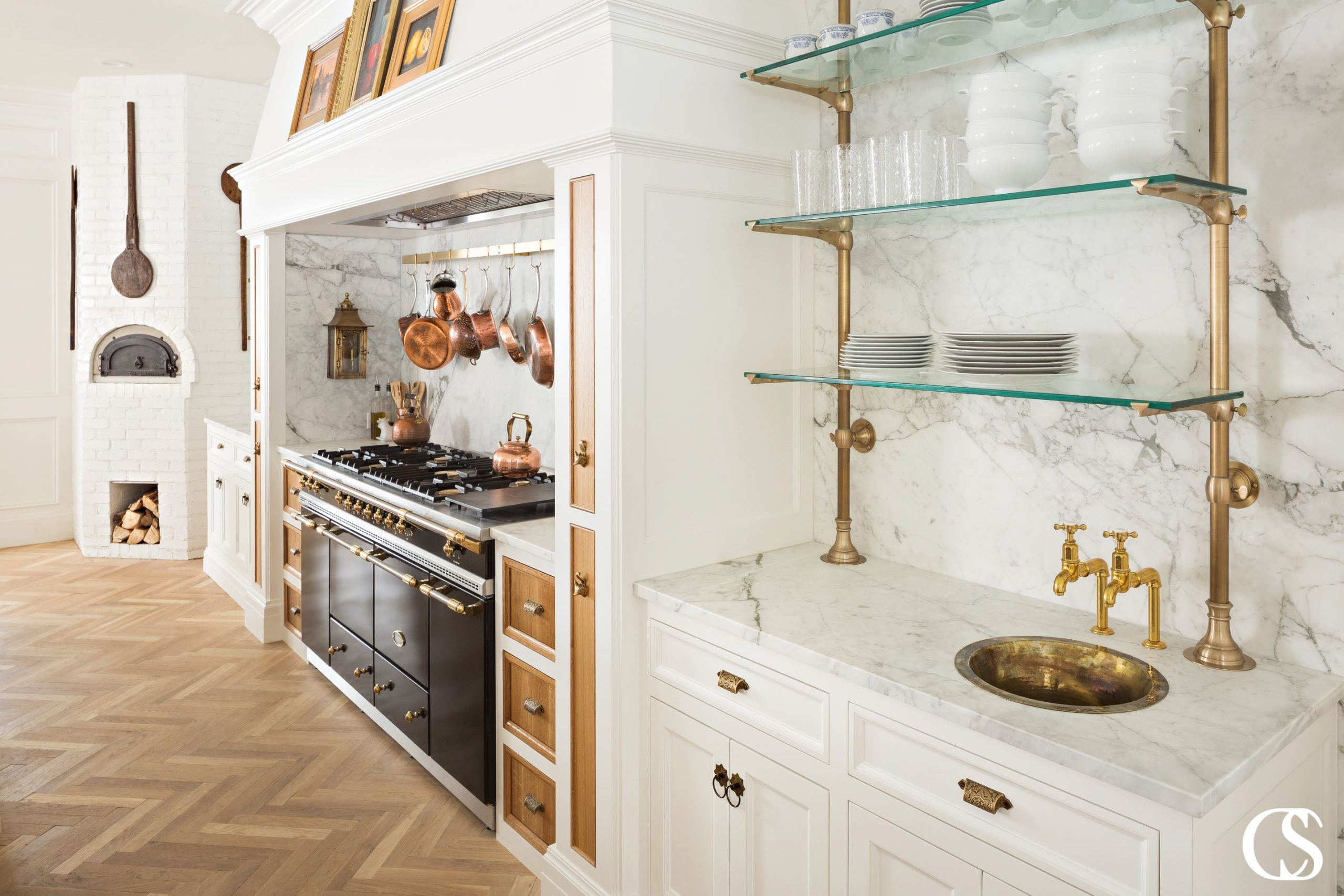 Custom kitchens are all as unique as their homeowners. Want airy, glass open shelving? How about a touch of heat from your own brick pizza oven? Add in warm copper accents and cabinet fronts and you've got yourself a truly unique and incredibly usable kitchen.