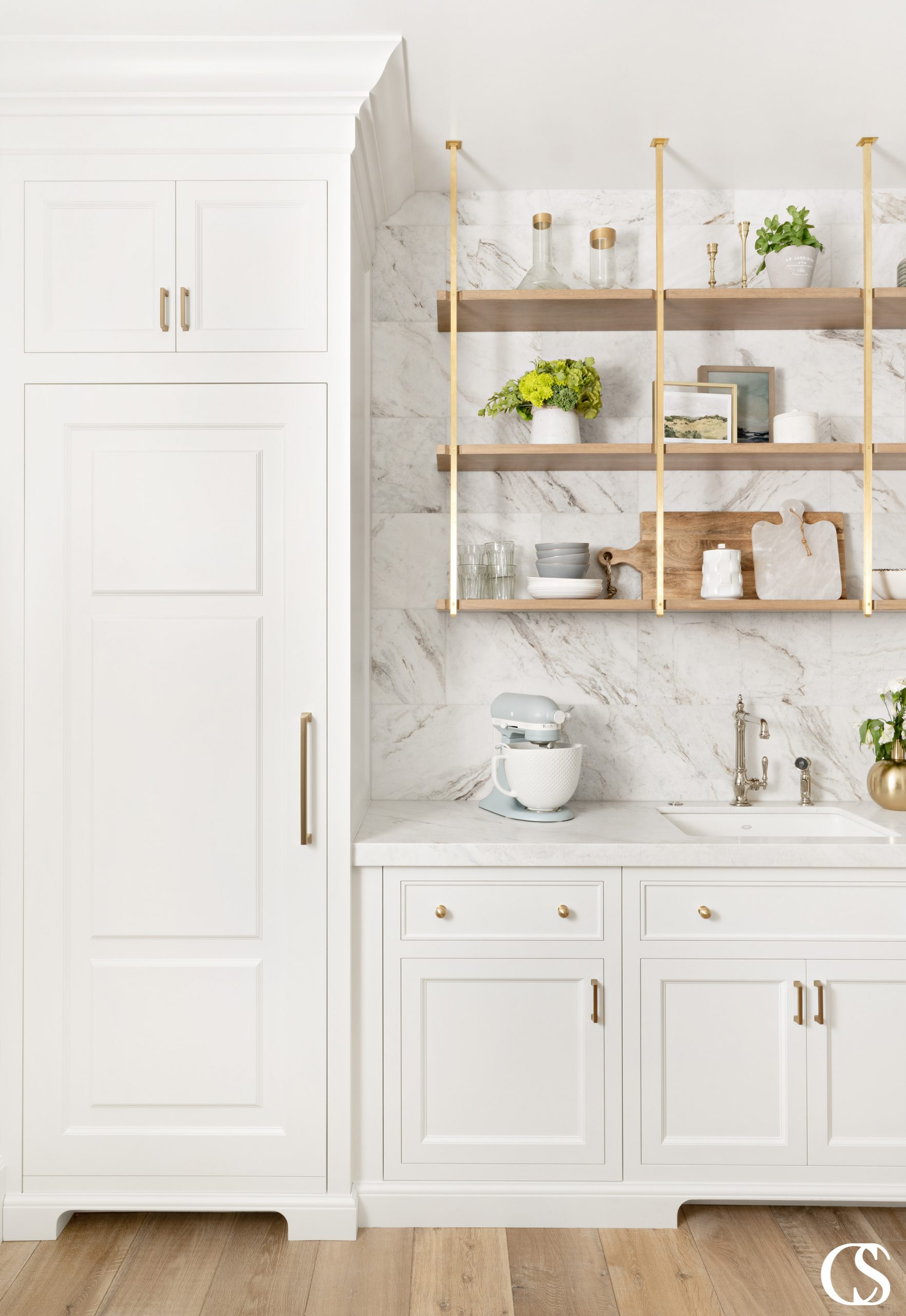 Custom pantry design will allow you to make a beautiful space for storing kitchen items that doesn't have to feel like a grocery store stockroom.