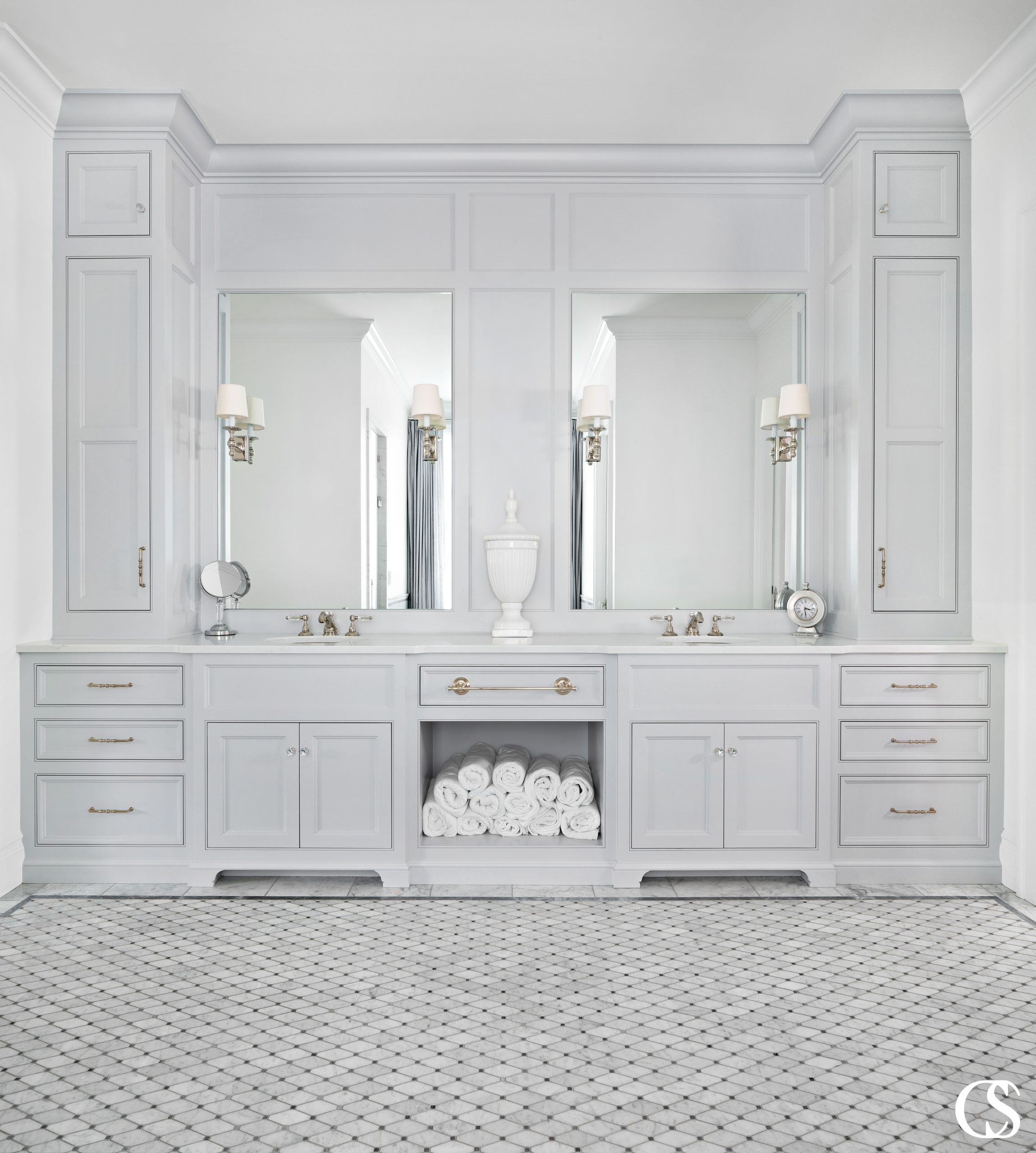 When a bathroom is meant to serve many, it's important to have two sinks and easily accessible towels like in this custom two sink bathroom design.