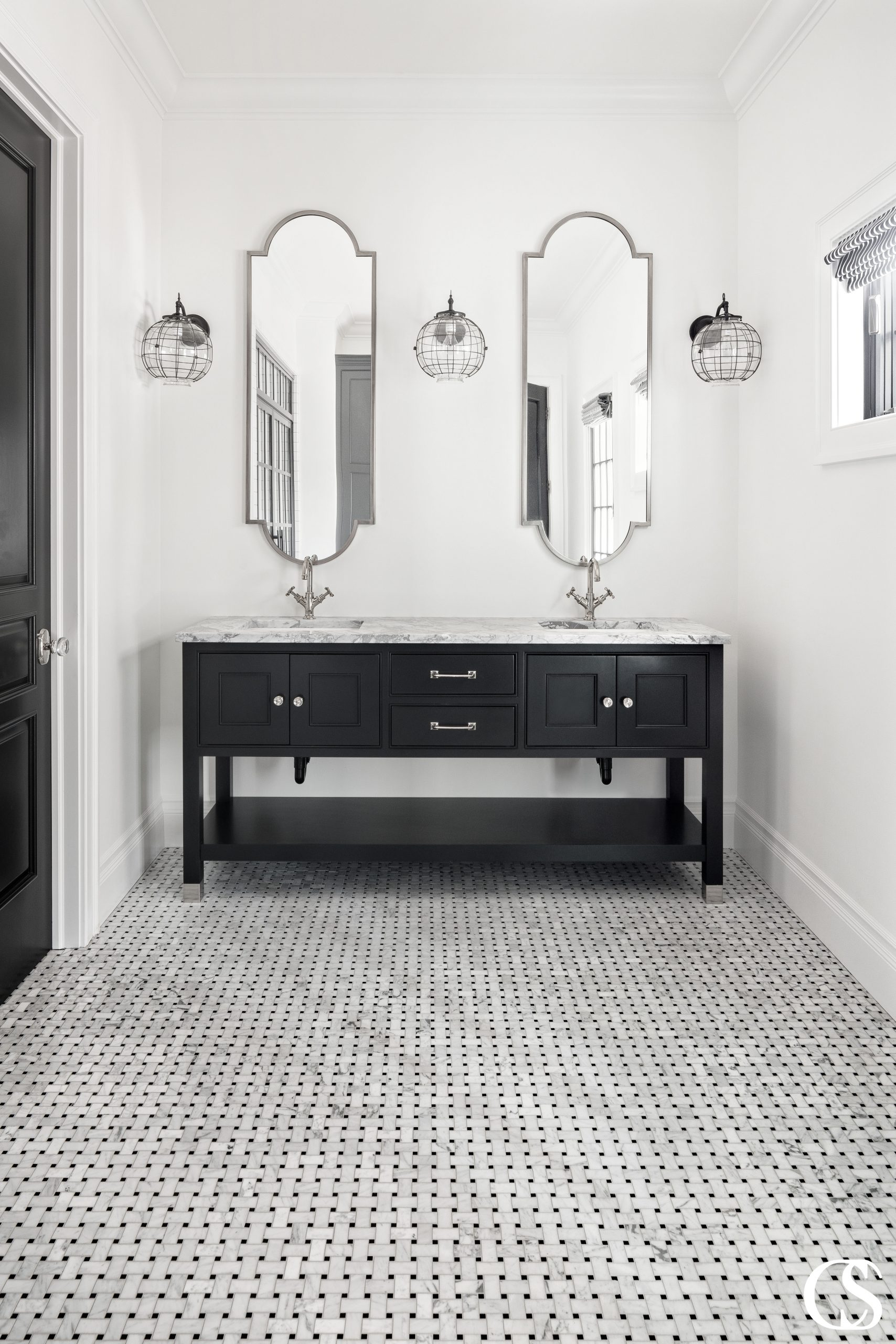 Don't sell your guest bathroom short! Even smaller spaces can accommodate custom two sink bathroom designs.