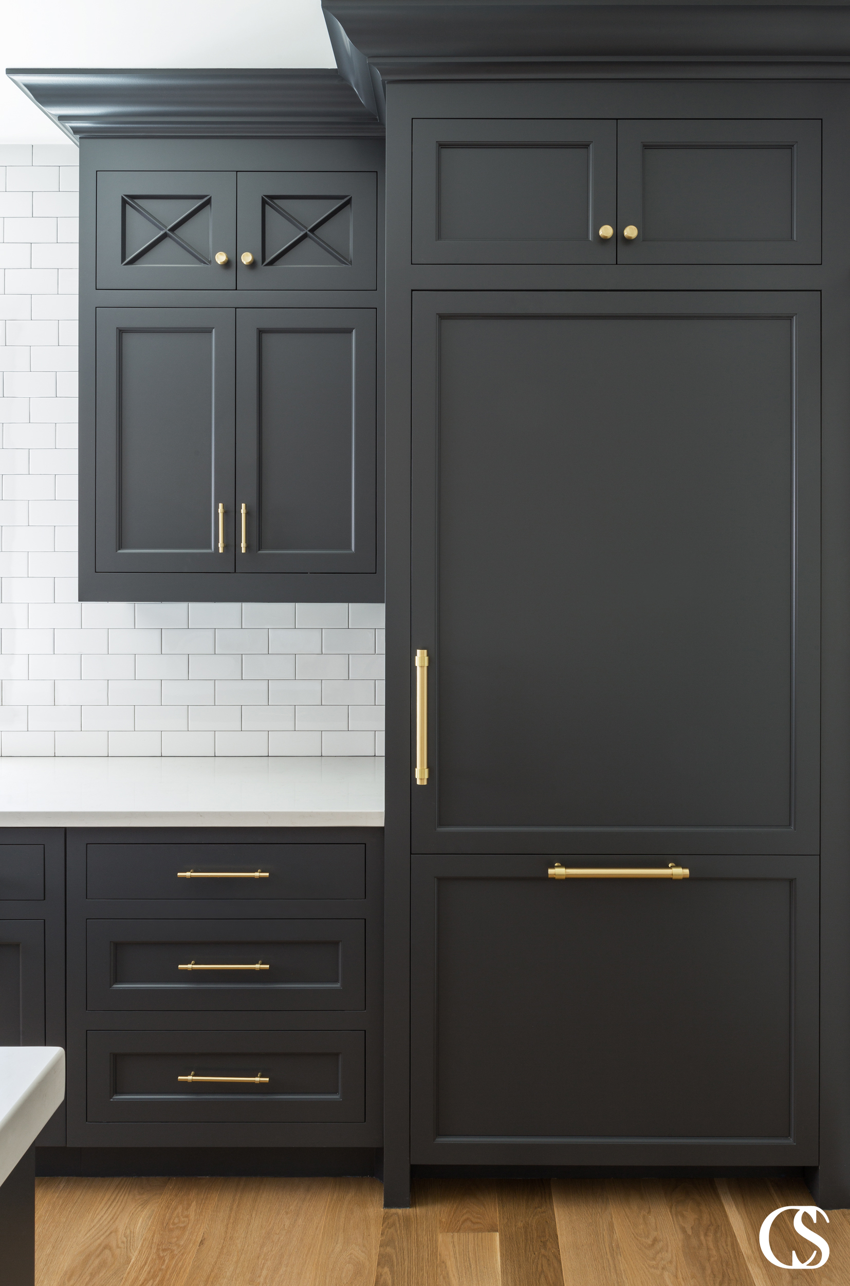 The flat panel cabinet doors in this black kitchen cabinet design create a timeless effect in a three tone kitchen.