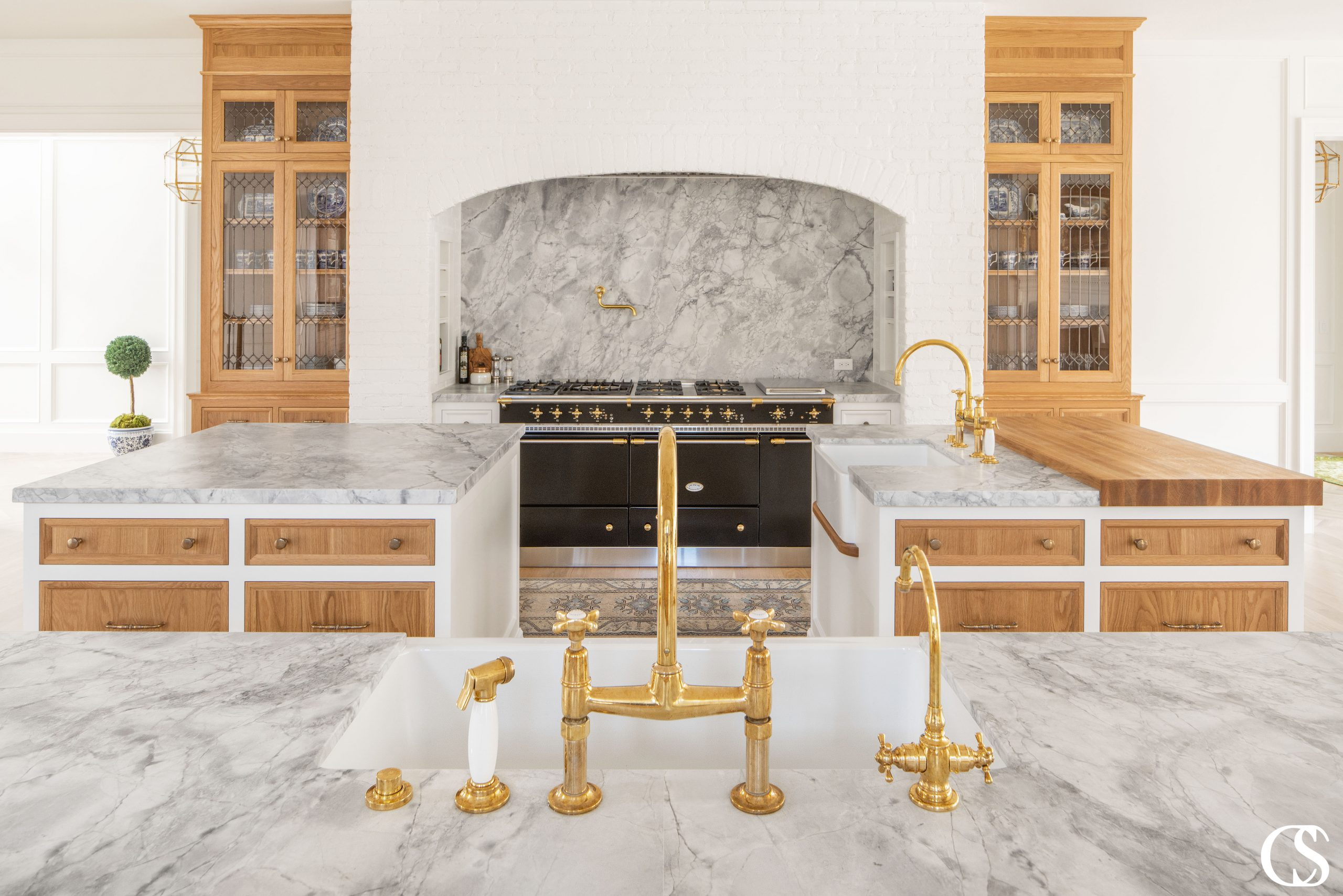 Custom kitchen cabinet design could mean three uniquely designed kitchen islands, all of which can perform a different function for your space.