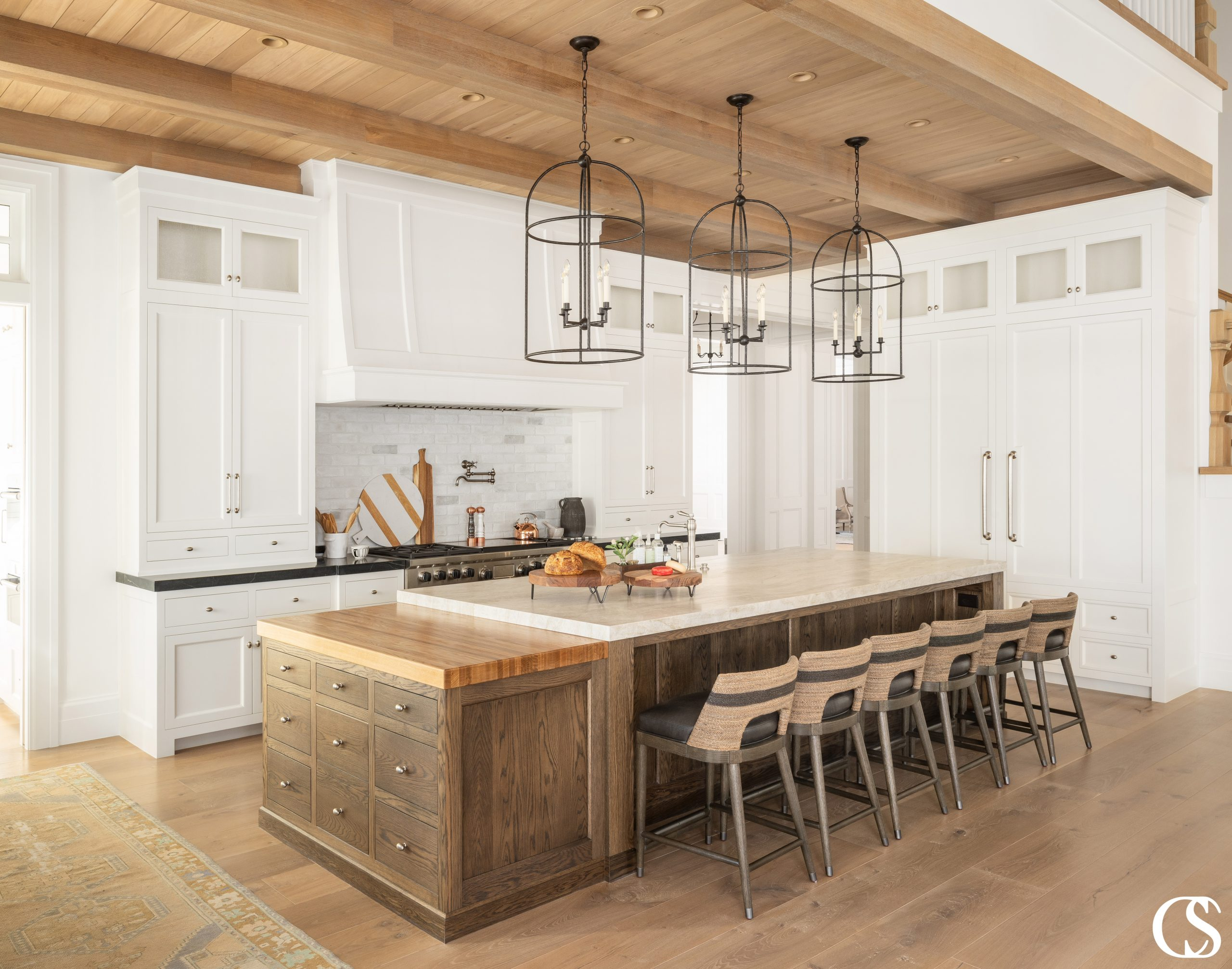 Pairing white with unique natural wood kitchen cabinets may be just the key to unlocking a perfectly homey, yet bright and open kitchen.