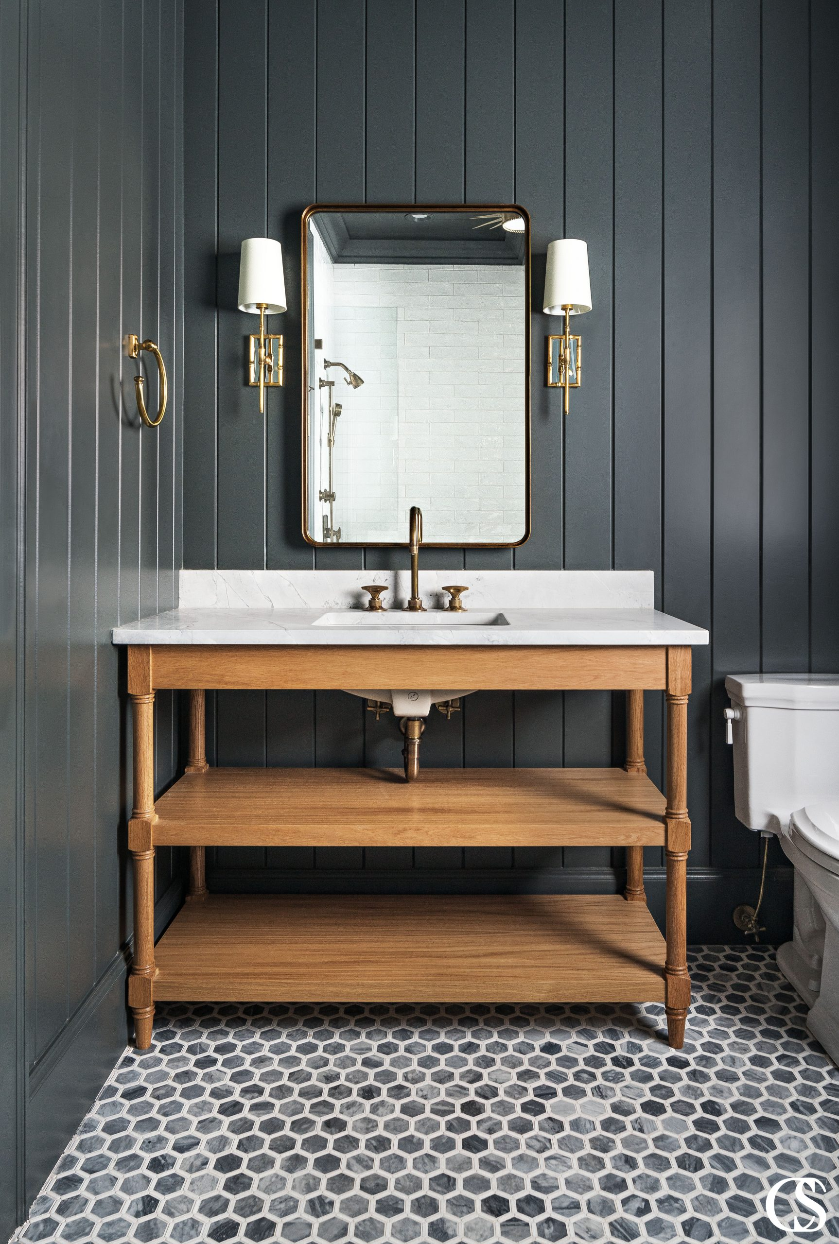 Vanity cabinets don't have to be built-ins. Free-standing, open bathroom cabinets can have open shelving in lieu of closed cabinets. They also can feature furniture-style details.
