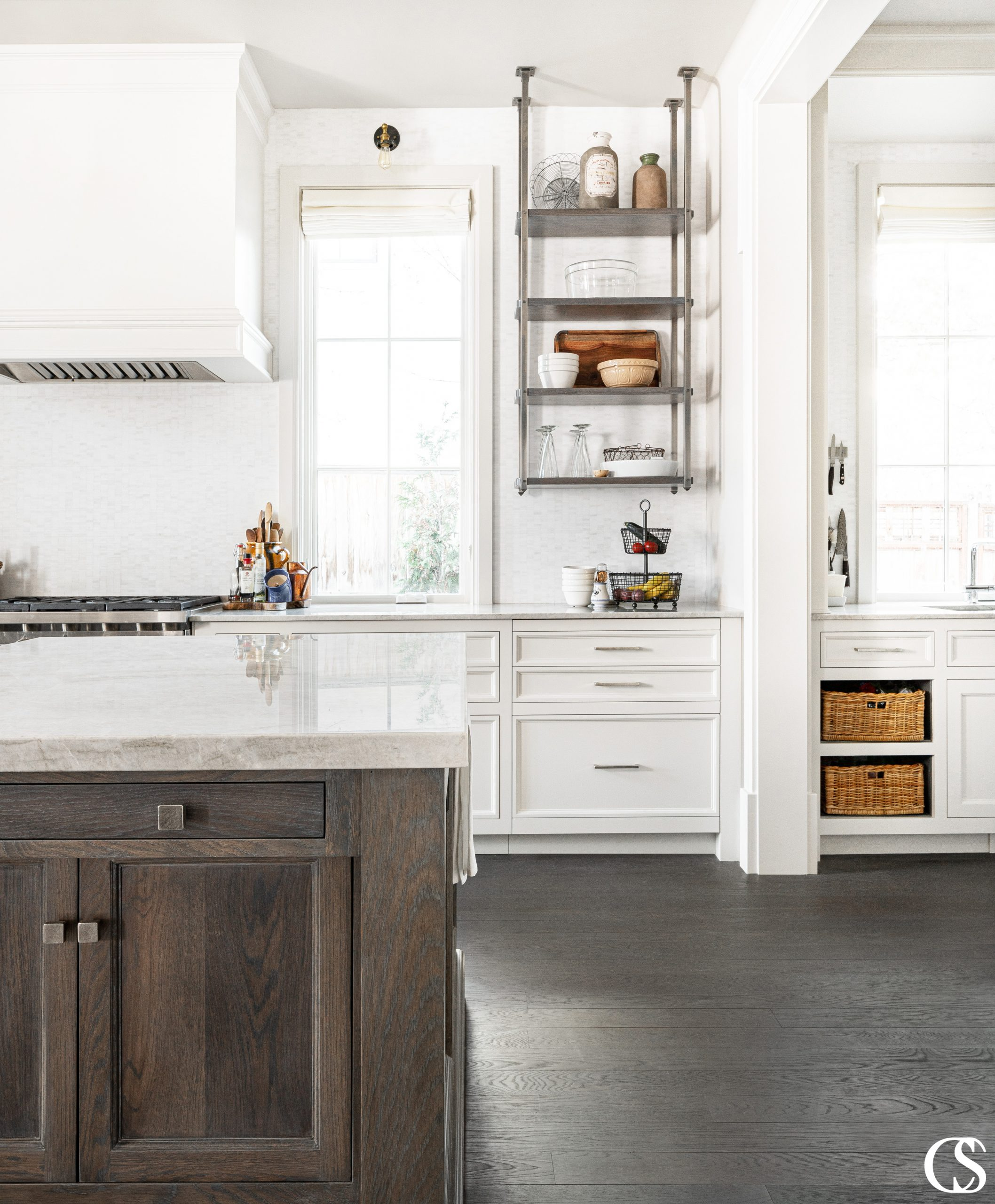 A custom oven hood—also known as a custom range hood cover—can play multiple important roles at the center of your kitchen.