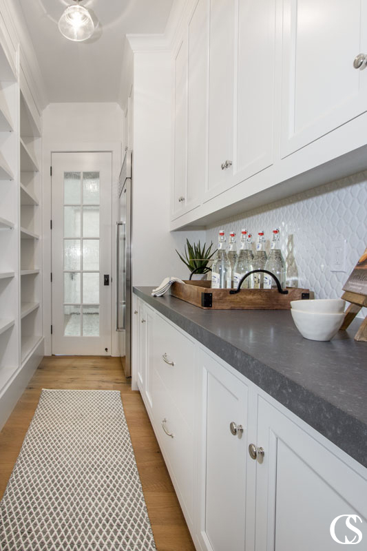 Custom pantry cabinets should solve the problems the kitchen can't (or chooses not to)—storing food on easy-to-see shelves, tucking away smaller appliances in cupboards, and generally creating a more clean and functional kitchen space.