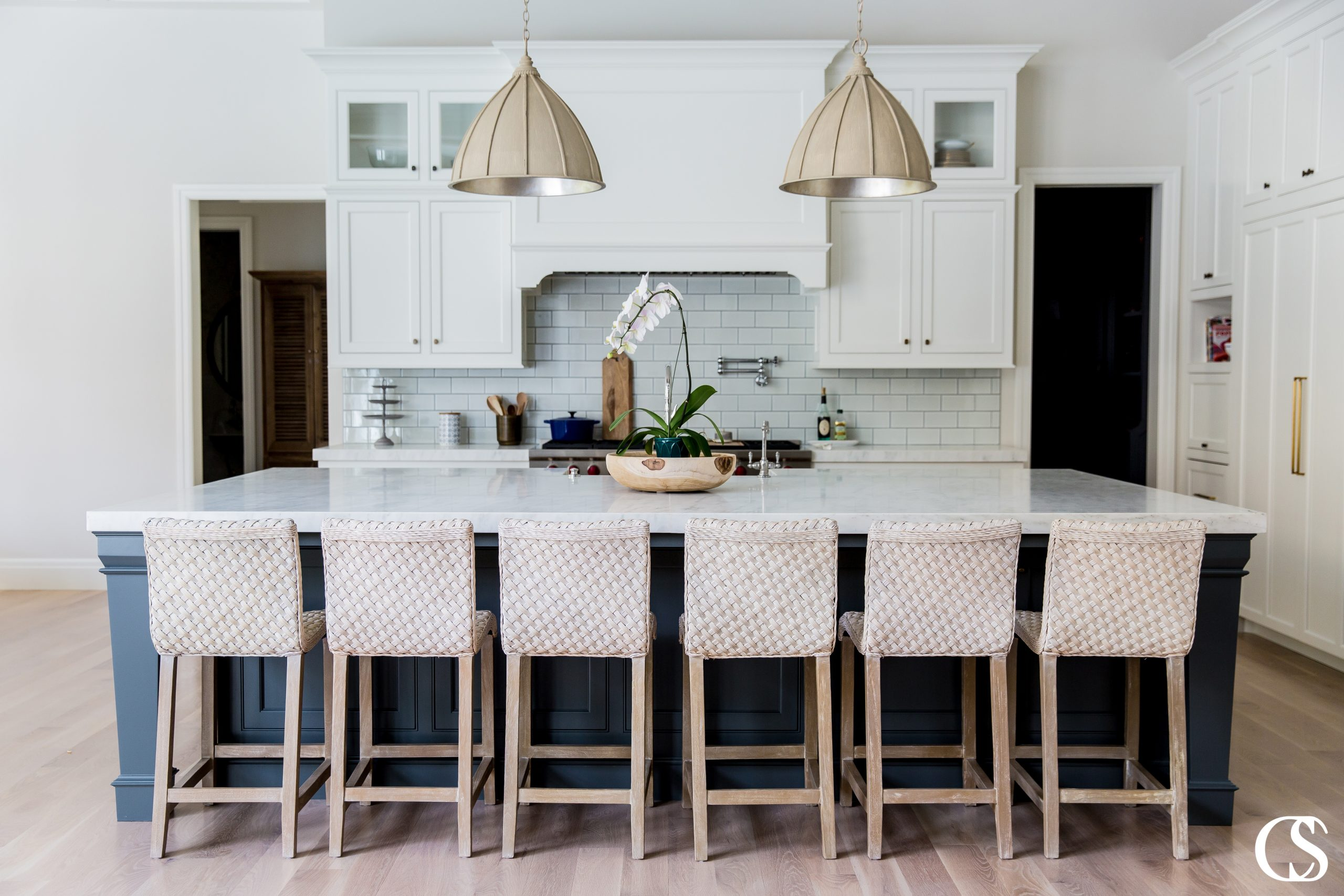 Trendy custom kitchen designs come in every shape, size, and color imaginable. This sweet white kitchen may not be huge but every detail of the inset cabinetry packs a punch.
