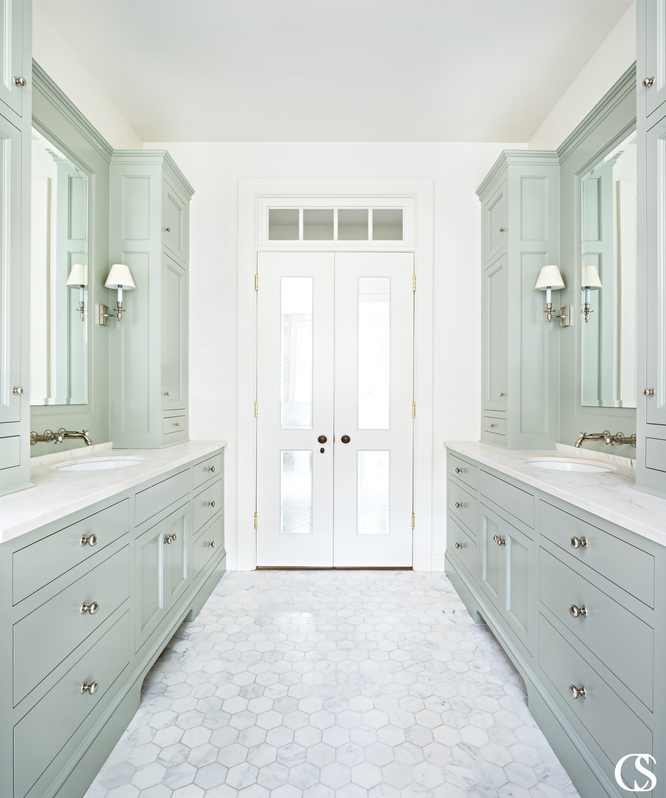 A common misconception with bathroom vanity cabinets is that a vanity is all one cabinet. But you can see with this unique bathroom cabinet design and color, a vanity can be almost any configuration that fits your space and needs.