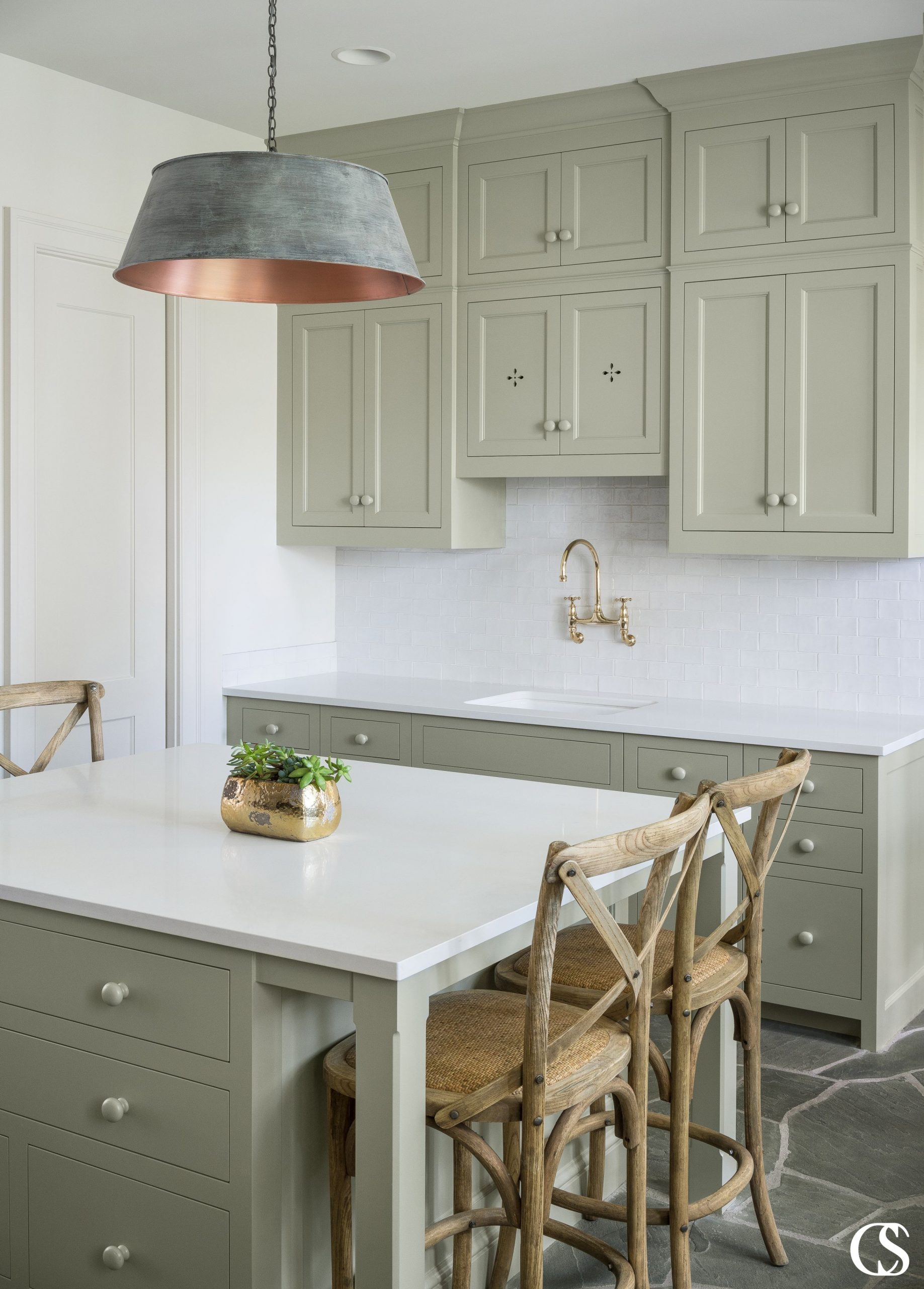 Pastel, muted, even lighter grey-toned greens are good choices for cabinet colors—think sage or mint. They can still make a statement, but will also have longevity in your home. This is one of our favorite green paints on these unique custom cabinets.